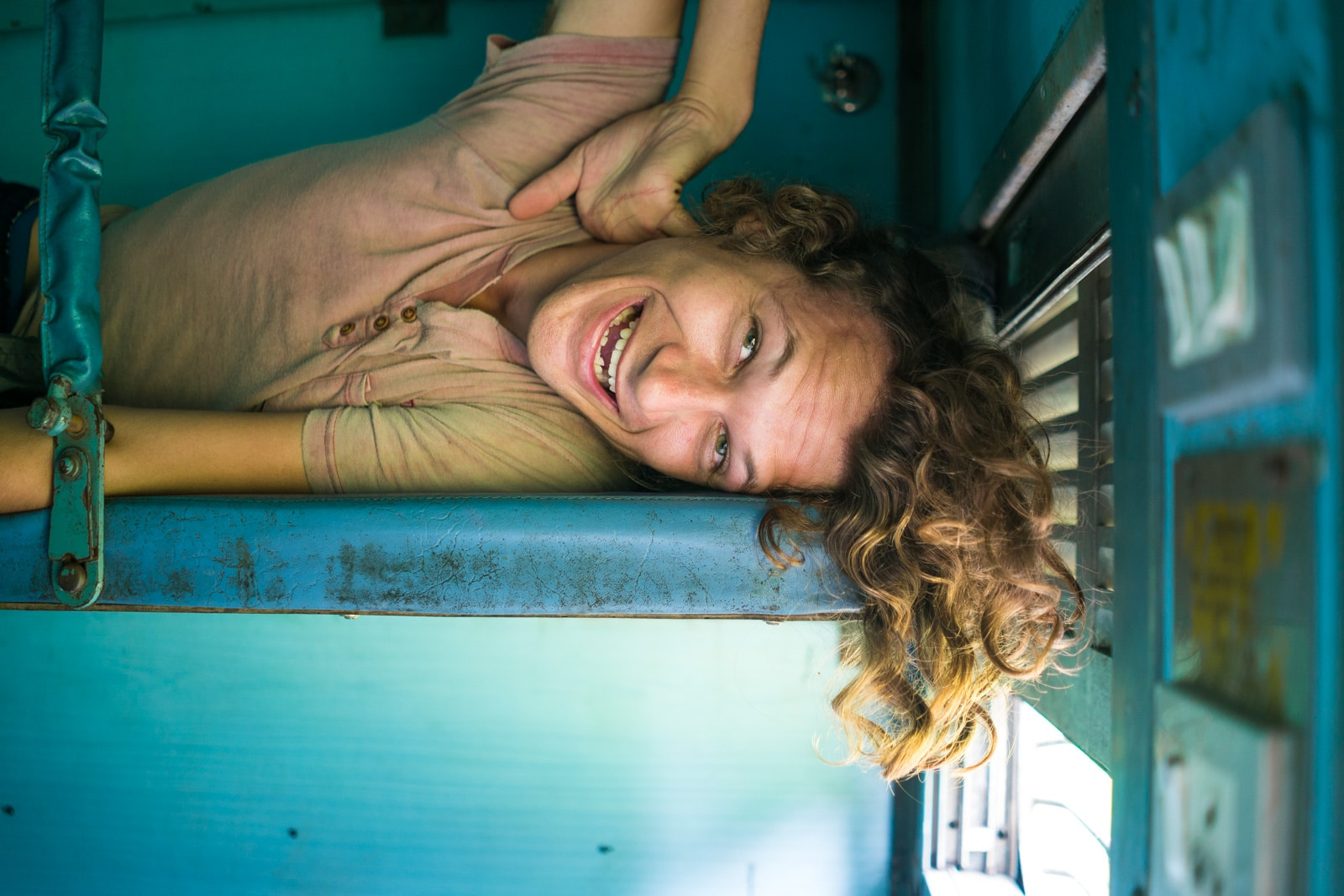 About Lost With Purpose Travel Blog - Sebastiaan lying down on a sleeper class train in India