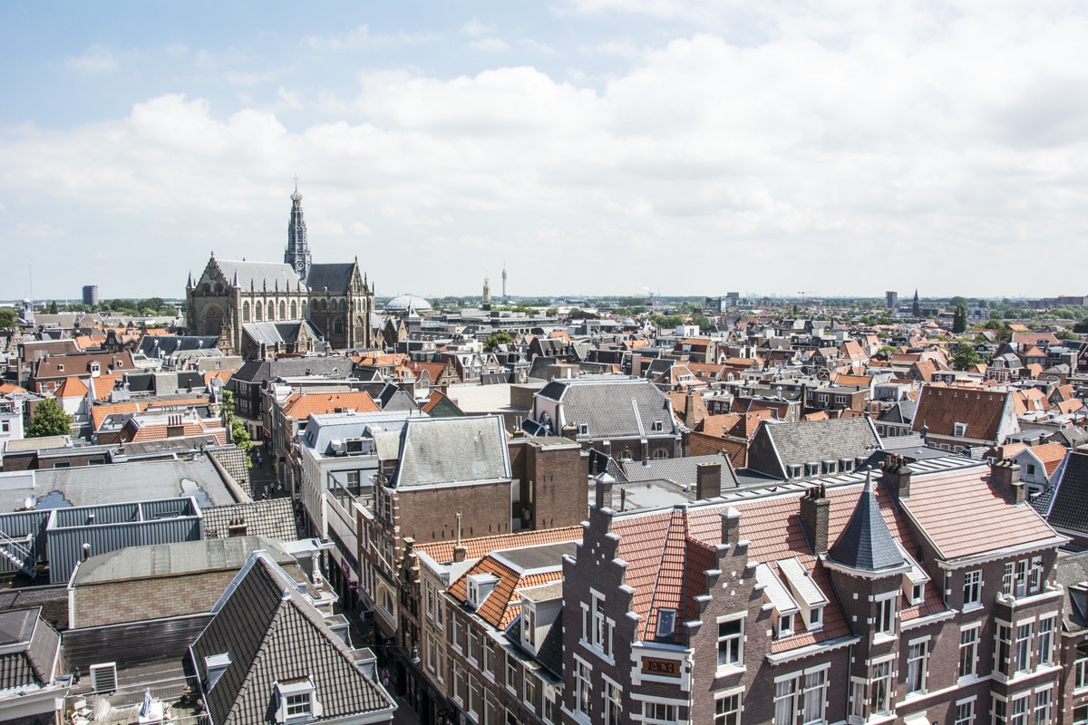 How to see tulips in the Netherlands on a budget - City skyline of Haarlem, The Netherlands - Lost With Purpose