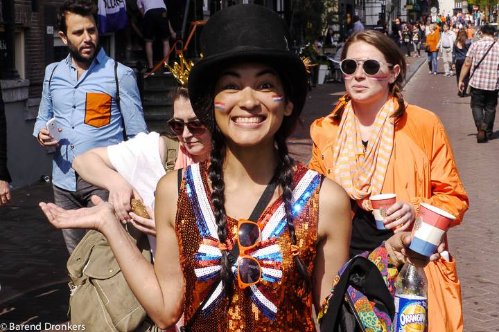 Girls dressed up in orange during a King's Day party
