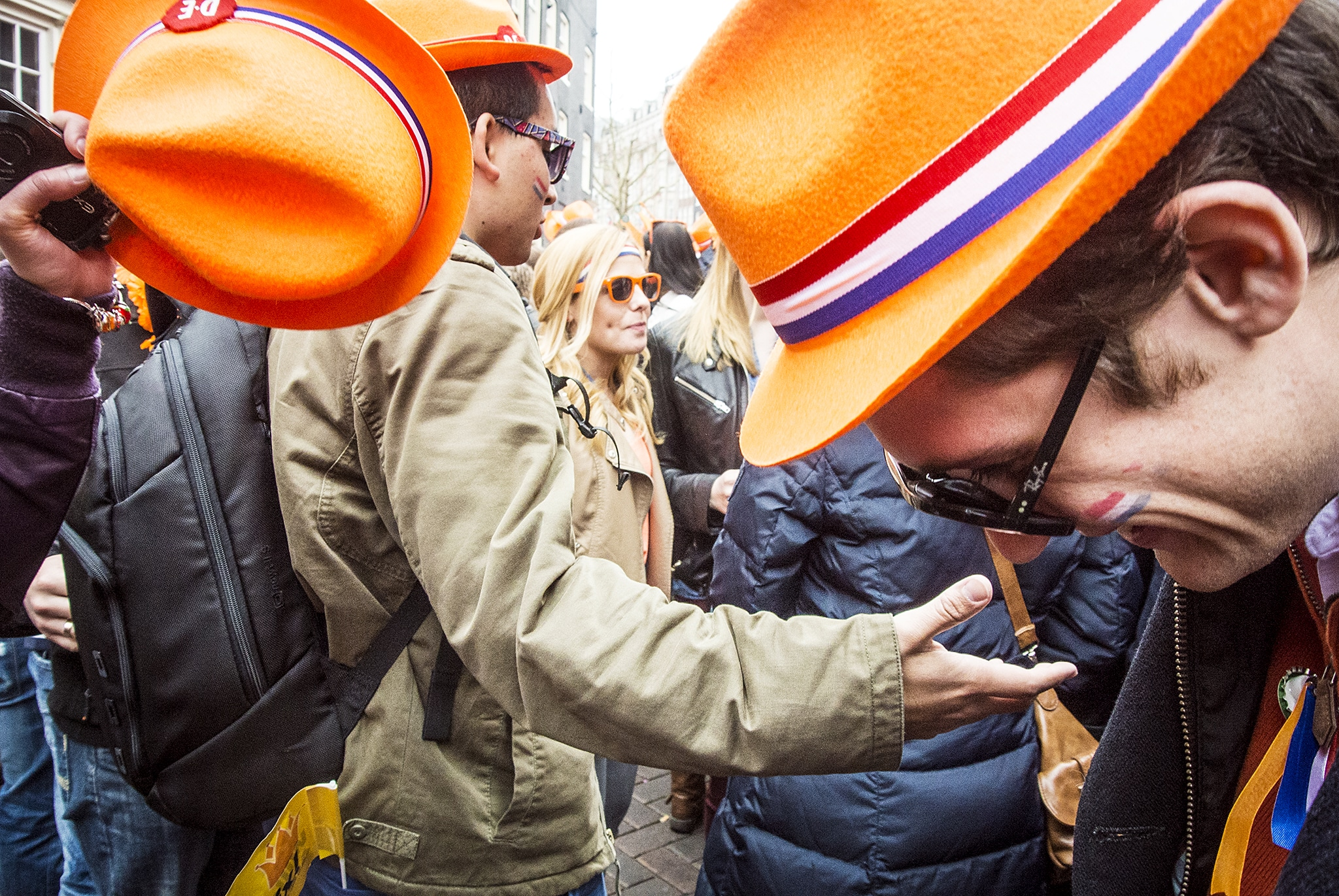 People wearing orange hats on the street for King's Day