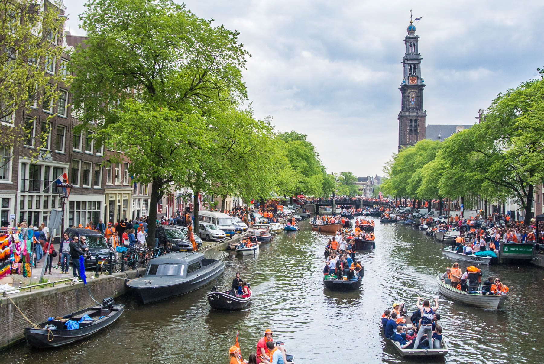 Boats in the canals in Amsterdam during King's Day
