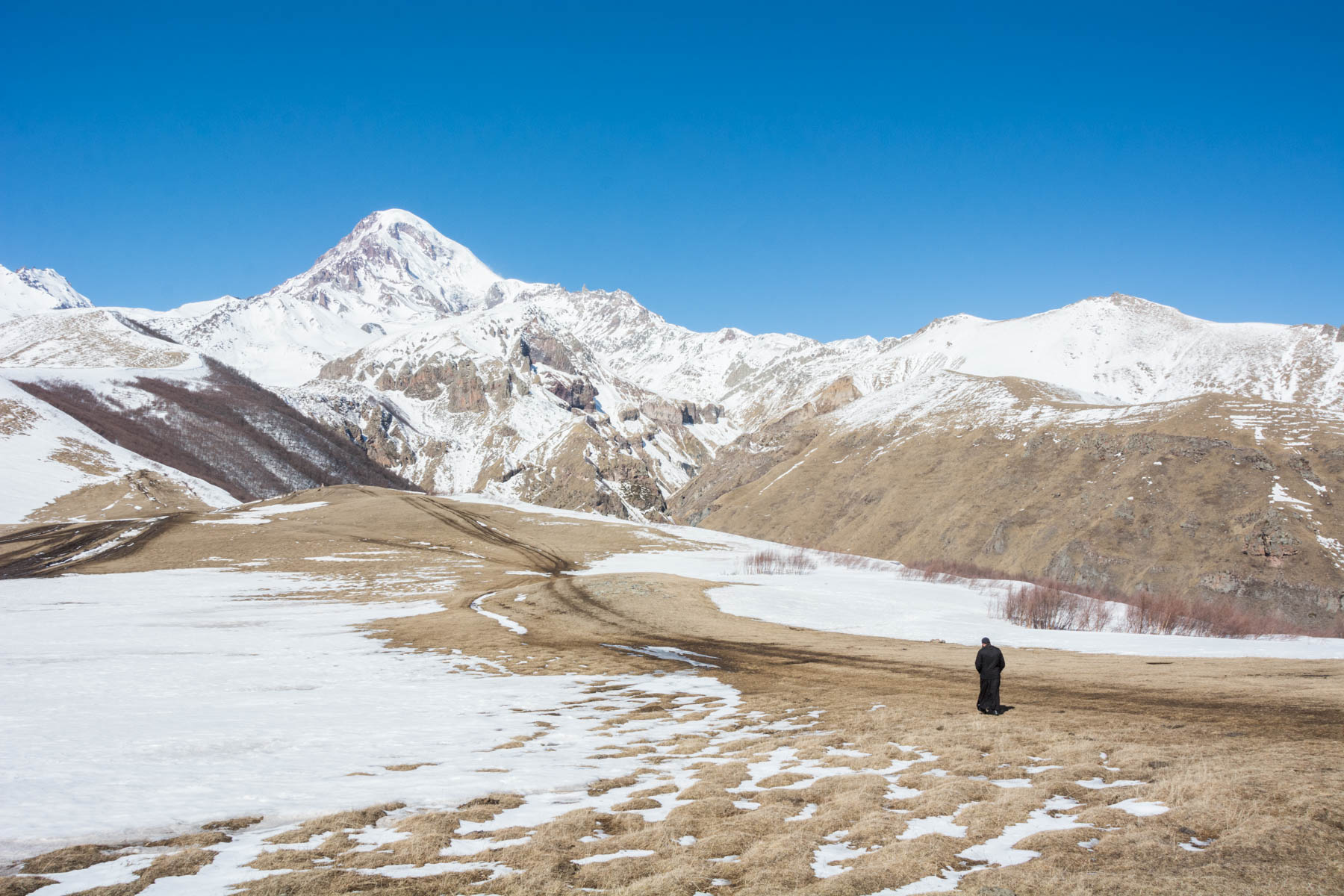 How much did one year of travel in Asia cost? - Monk in Kazbegi, Georgia - Lost With Purpose