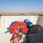 Riding in the back of a pickup truck on the longest border crossing in the world