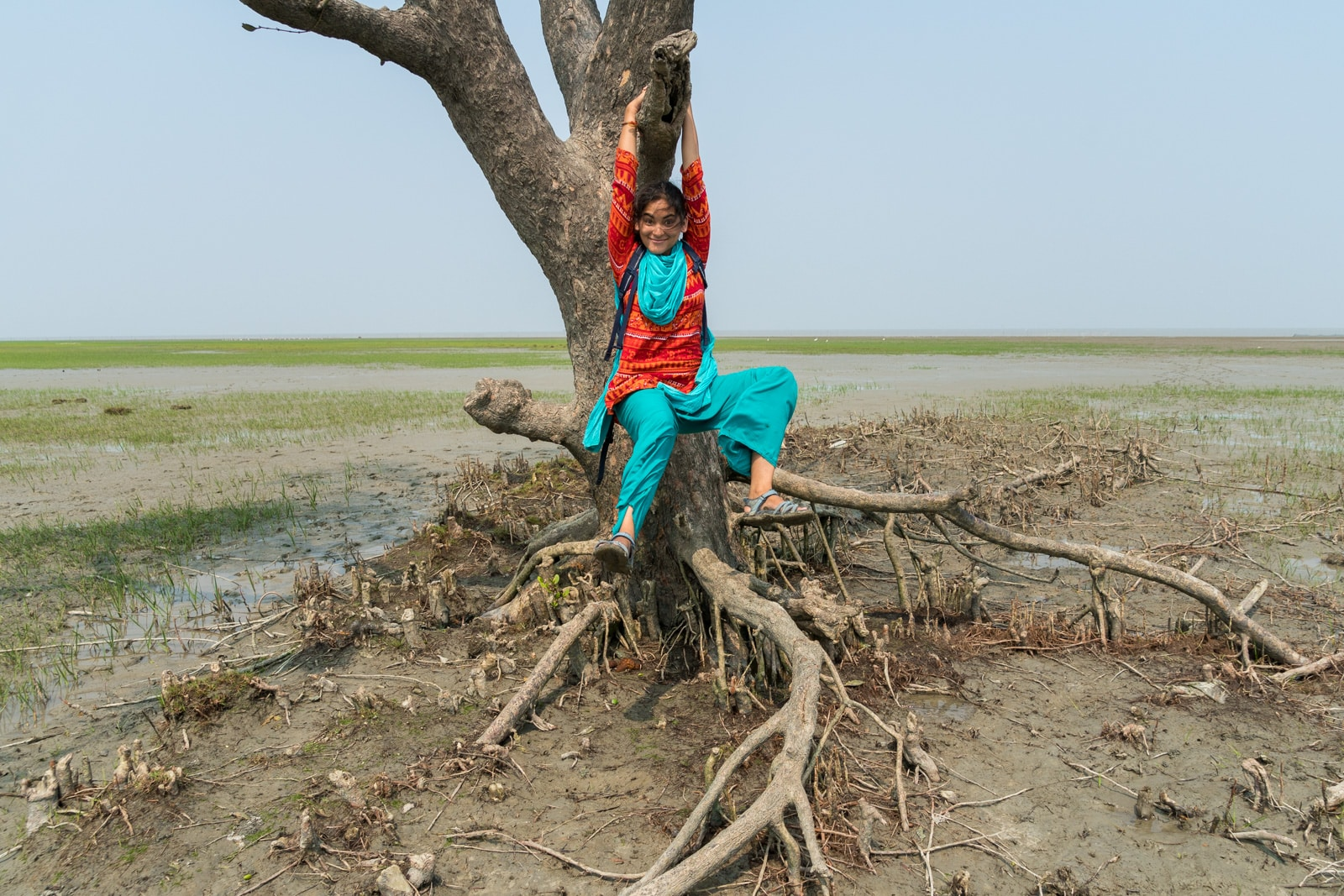 What is Lost With Purpose? - Alex swinging on a tree in Hatiya, Bangladesh - Lost With Purpose travel blog
