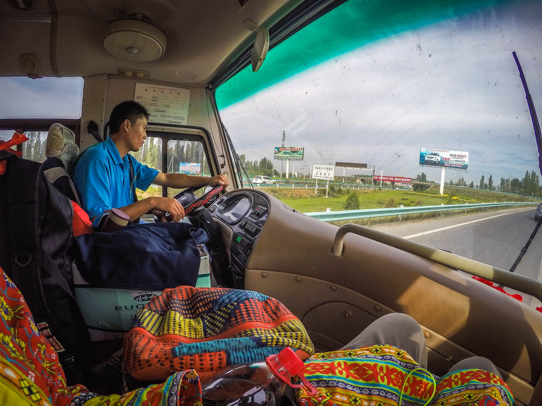 Riding the bus from Yining, China to the China - Kazakhstan border crossing at Khorgos