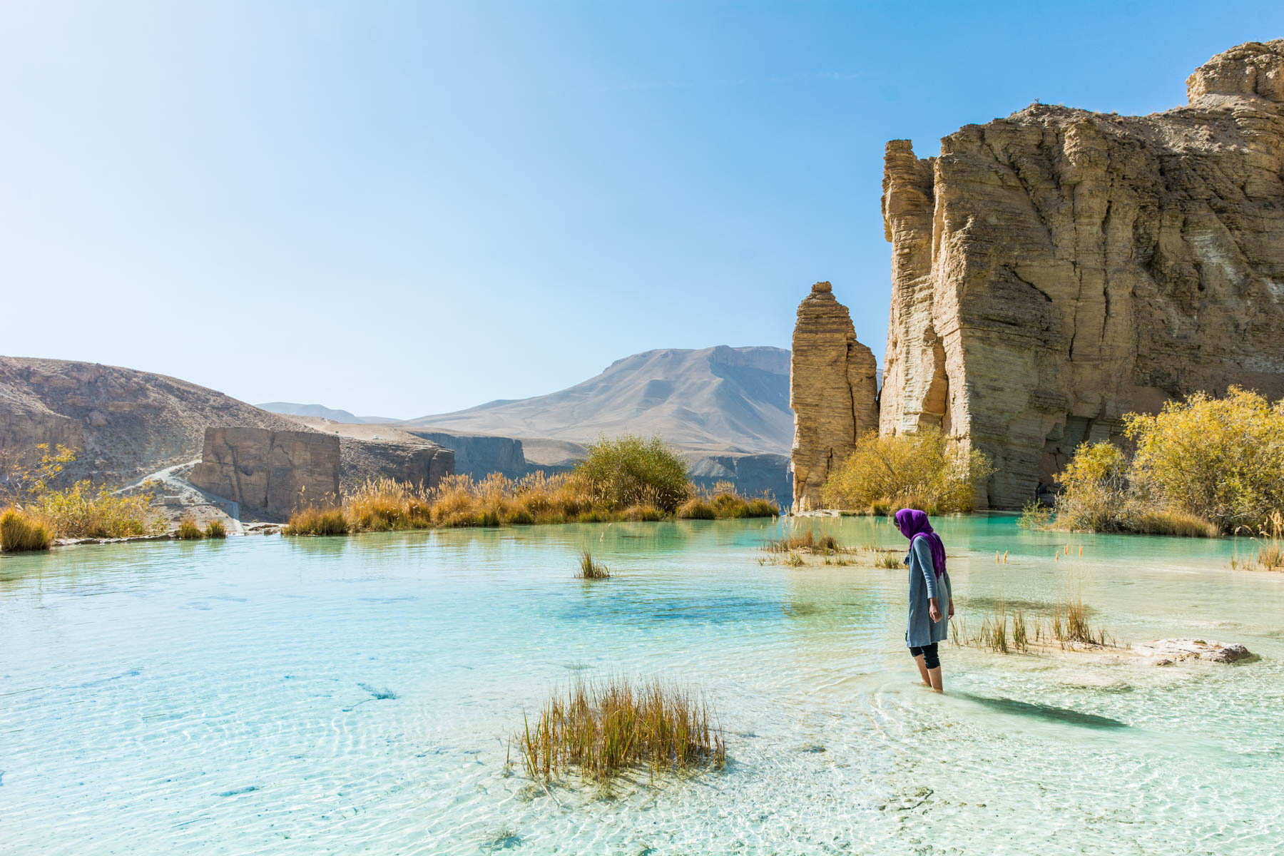 A girl standing in one of the lakes of Band-e-Amir in Afghanistan