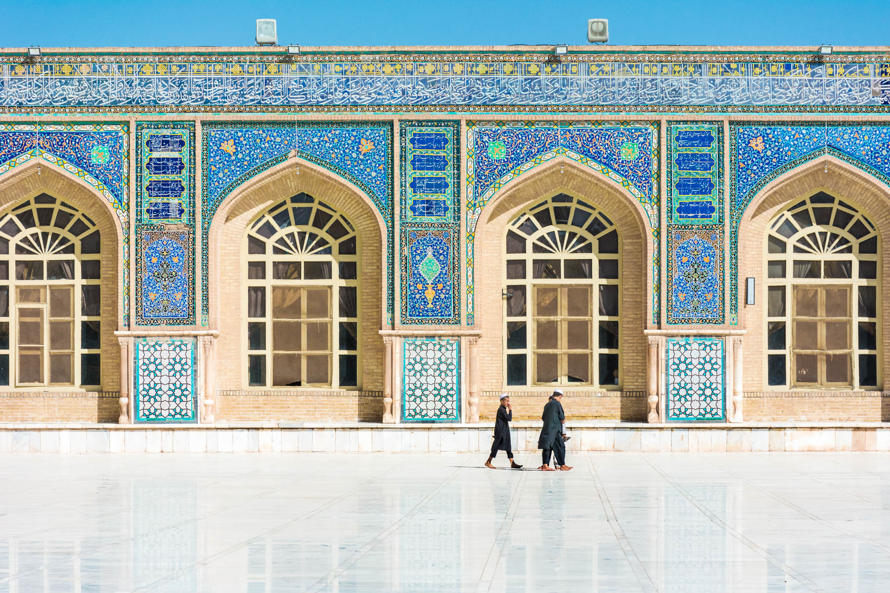 Boys walking in the Jame (Friday) Mosque in Herat, Afghanistan