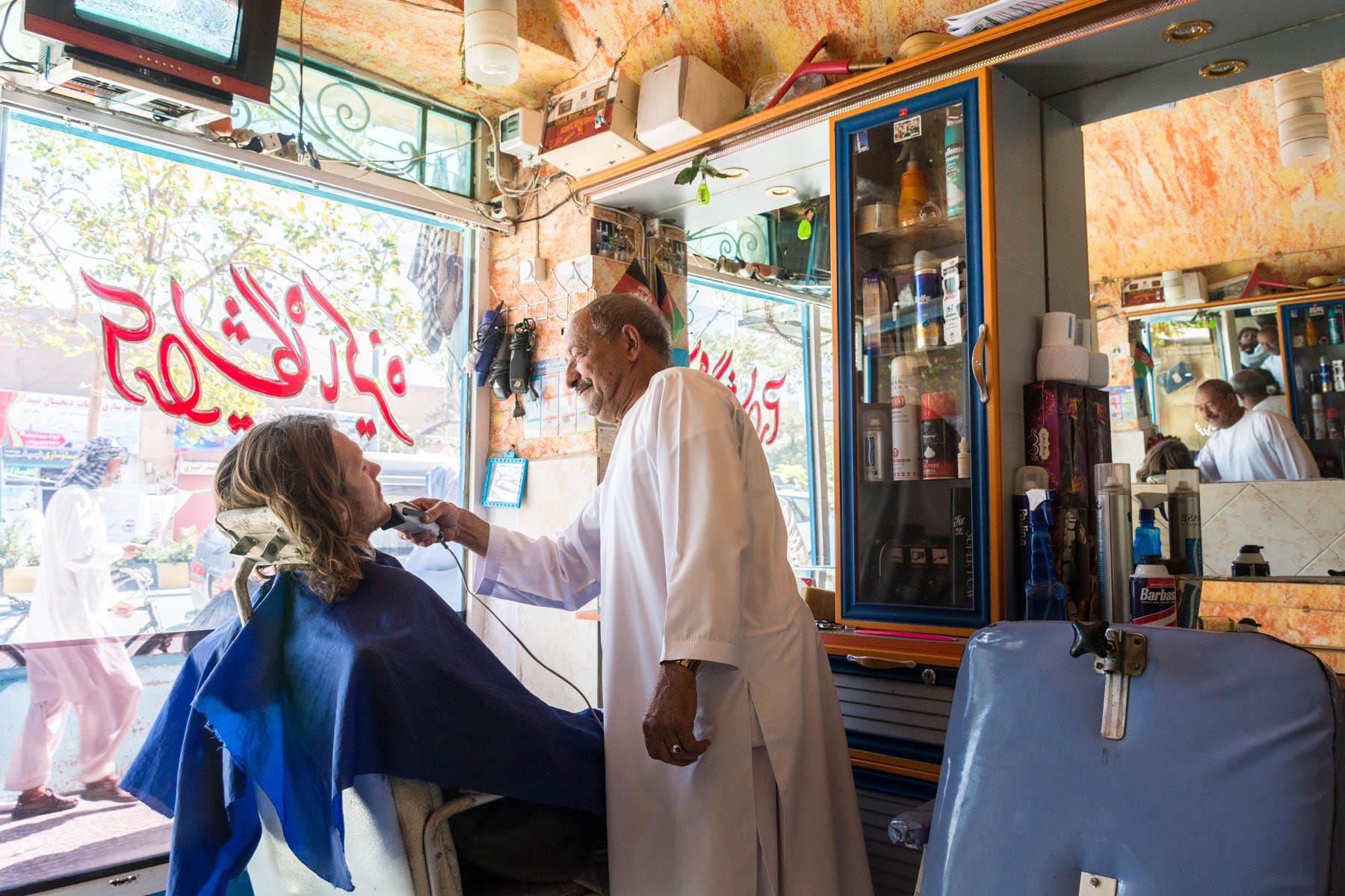 Man getting a shave in Herat, Afghanistan