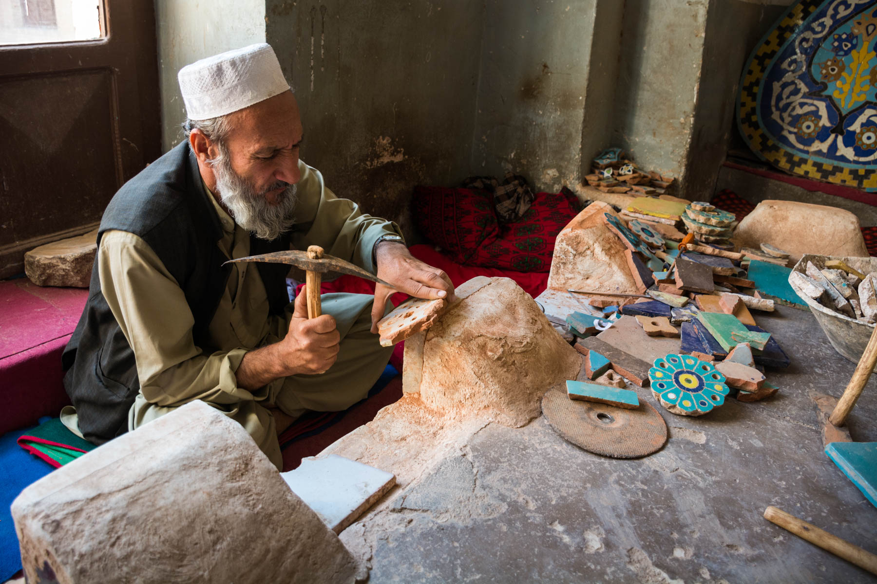 A tile maker chipping away at the Jame Mosque in Herat, Afghanistan