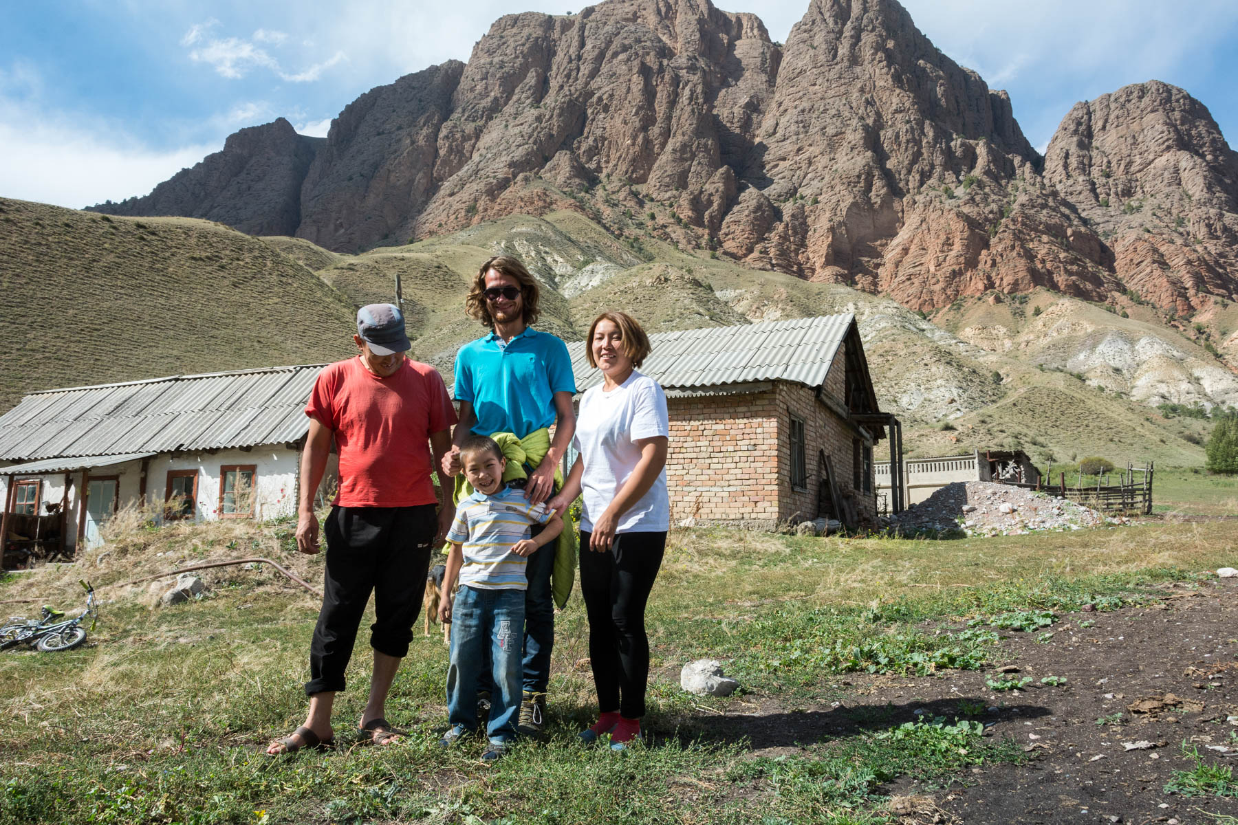Hanging out post-chai and snacks with a super sweet family in Min Kush, Kyrgyzstan - Lost With Purpose