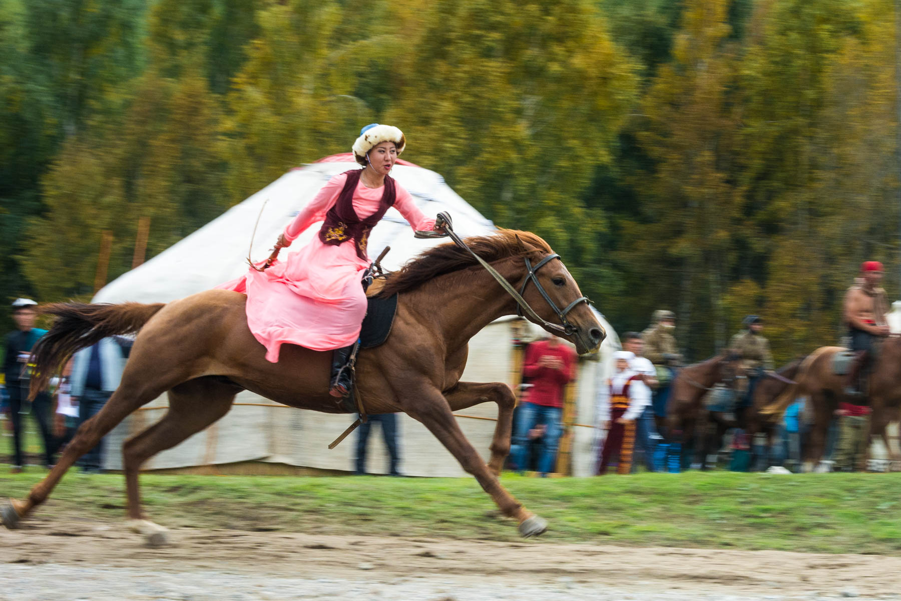 A performing woman riding a horse in Kyrgyzstan