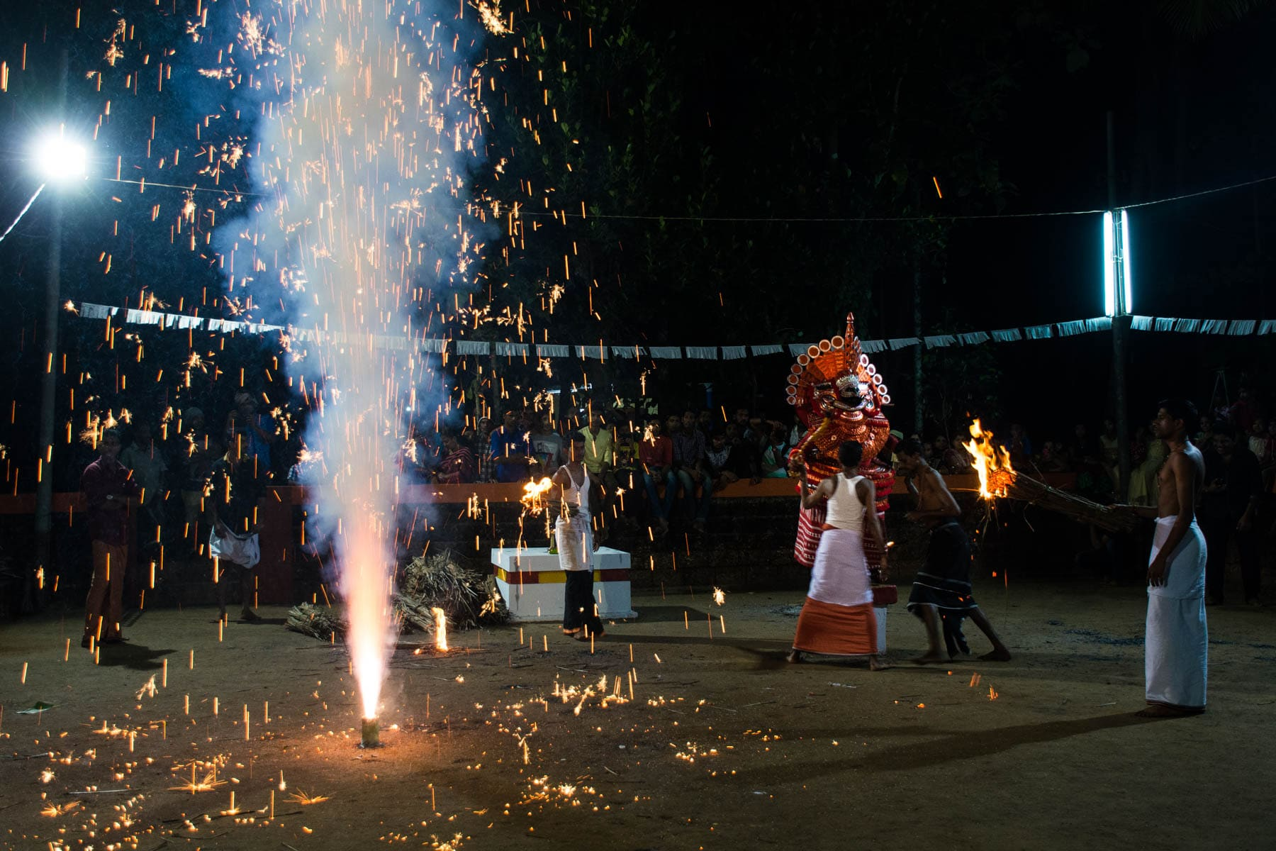 Fireworks going off during a Theyyam performance