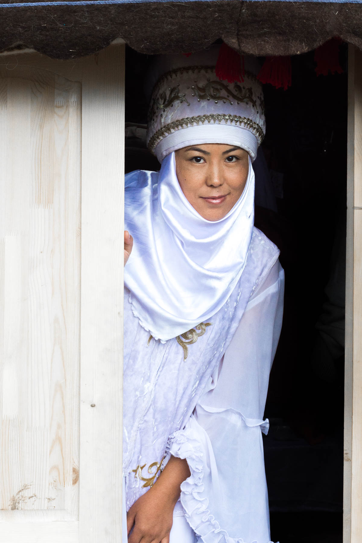 A Kyrgyz nomad girl in traditional clothes at the World Nomad Games
