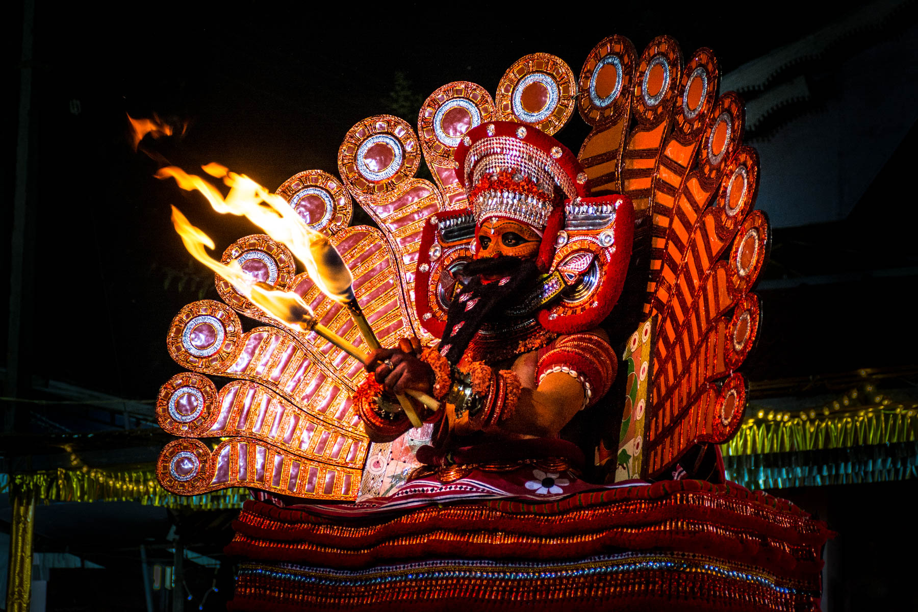 A Theyyam performer dancing in full trance