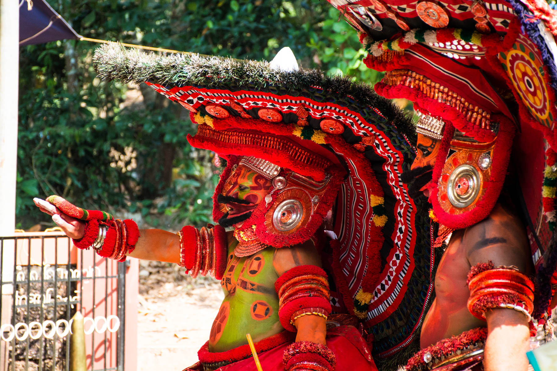Two Theyyam dancers in full custom