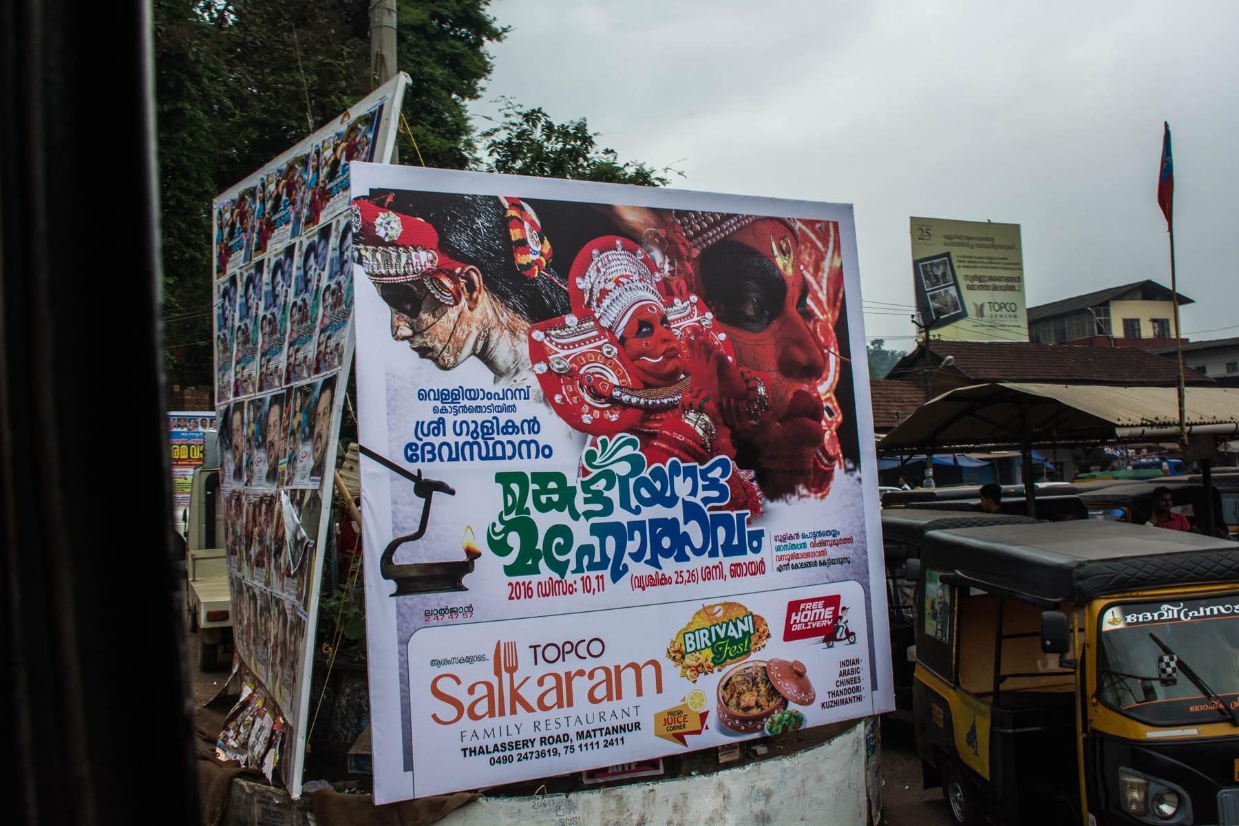 Sign telling where to see Theyyam in Kerala, India