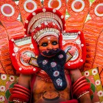 A man in costume at a performance of Theyyam in Kerala, India - Lost With Purpose