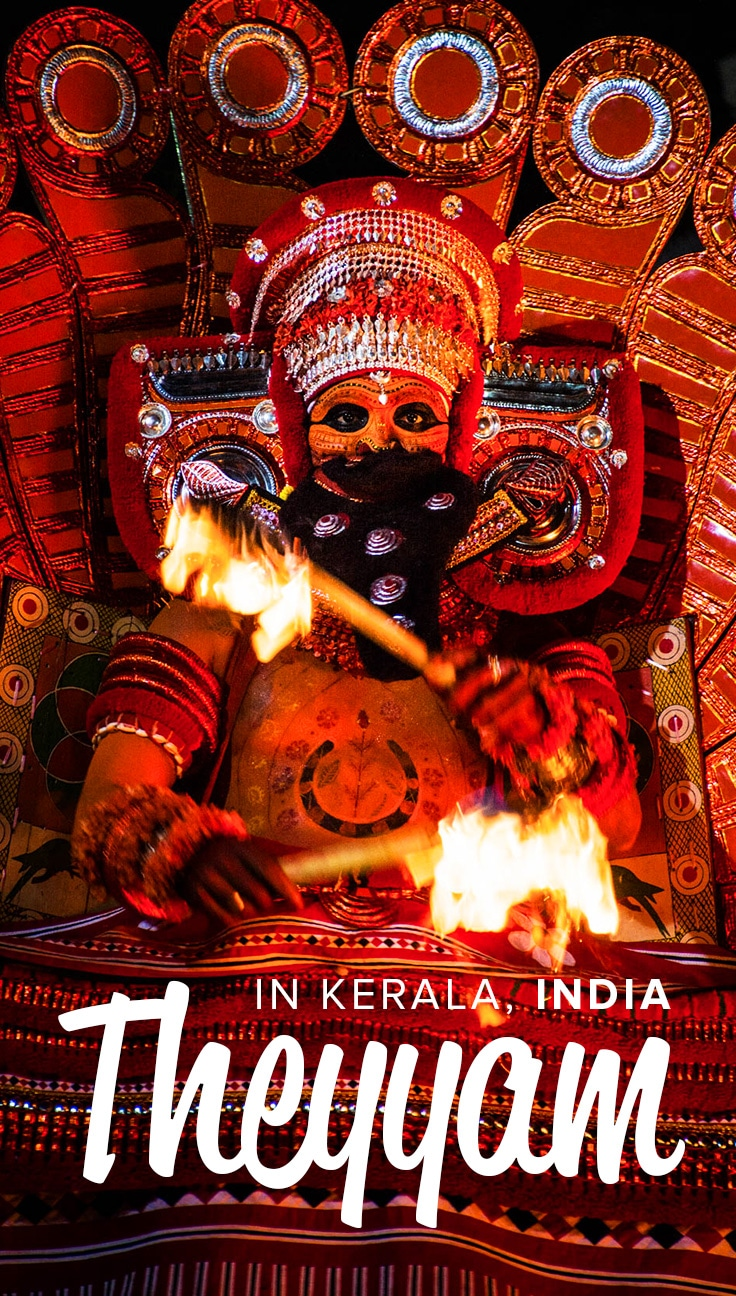 A theyyam performer in full outfiit in Kerala, India