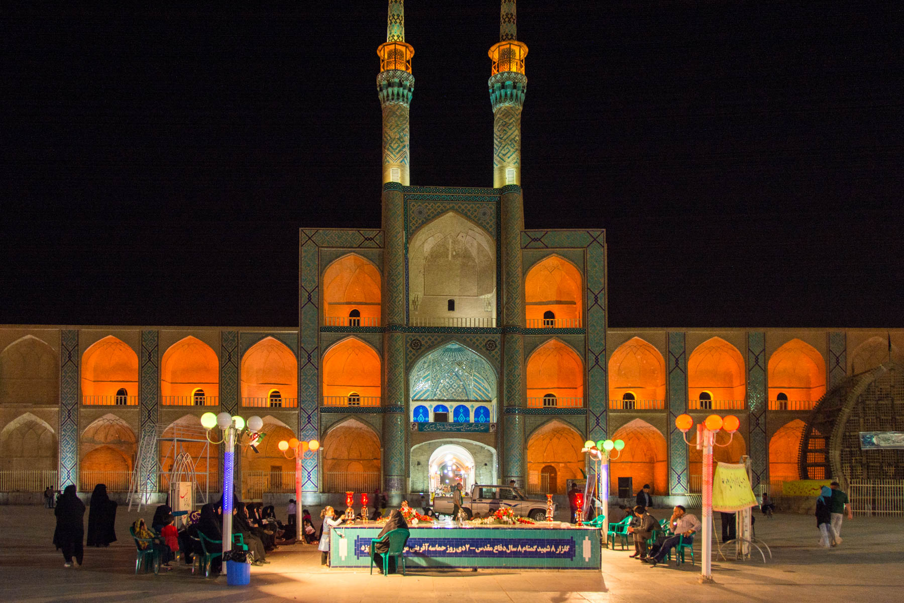 Two week Iran travel itinerary - Amir Chaghmagh mosque lit up at night - Lost With Purpose
