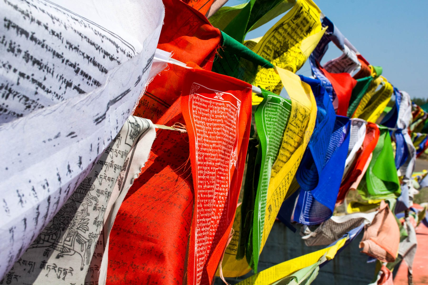 Visiting Namdroling Monastery in Bylakuppe, India - Tibetan Buddhist prayer flags in Bylakuppe, Karnataka, India - Lost With Purpose