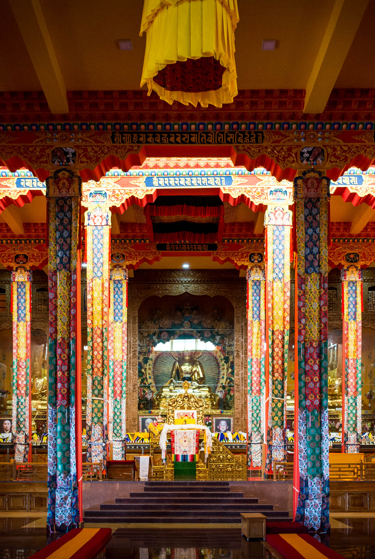 The interior of the serene Tashi Lhunpo monastery, a Buddhist monastery in Bylakuppe, India's second largest Tibetan settlement. Bylakuppe is a great destination to visit if you're looking for off the beaten track places in Karnataka state!