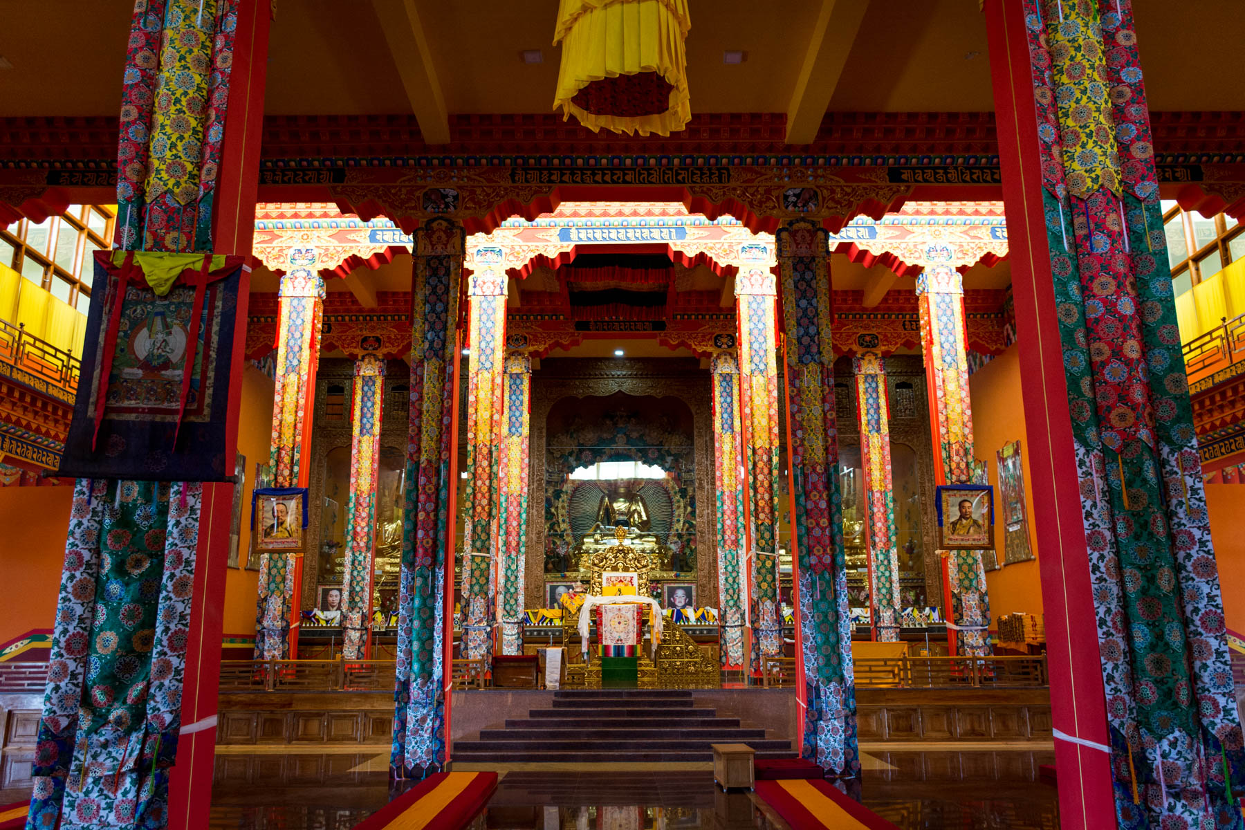 Visiting Namdroling Monastery in Bylakuppe, India - The interior of Tashi Lhunpo Buddhist monastery in Bylakuppe, Karnataka, India - Lost With Purpose