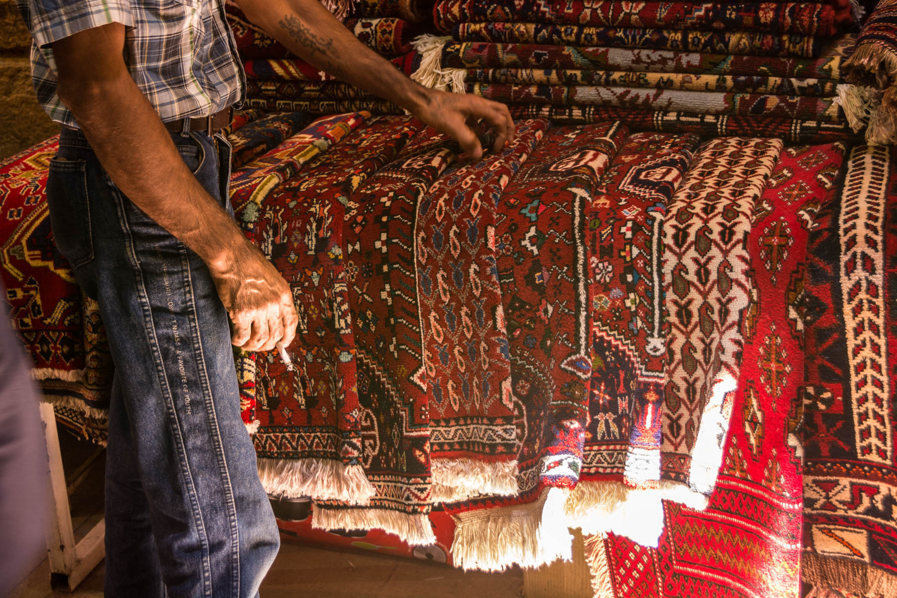 Two week Iran travel itinerary - Persian carpets in the Vakil Bazaar in Shiraz, Iran - Lost With Purpose