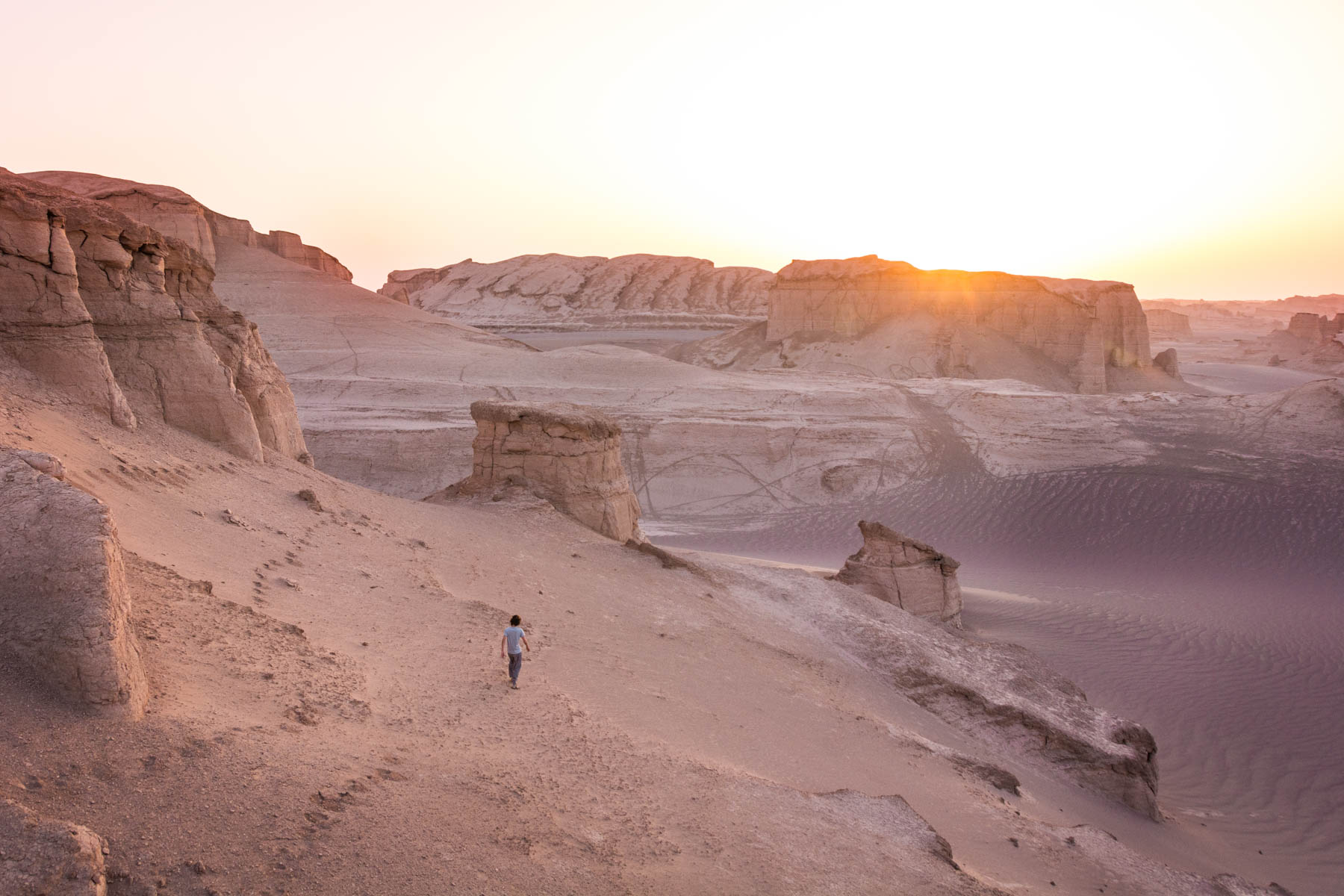 Two week Iran travel Itinerary - Sunrise over the Kaluts desert near Kerman, Iran - Lost With Purpose