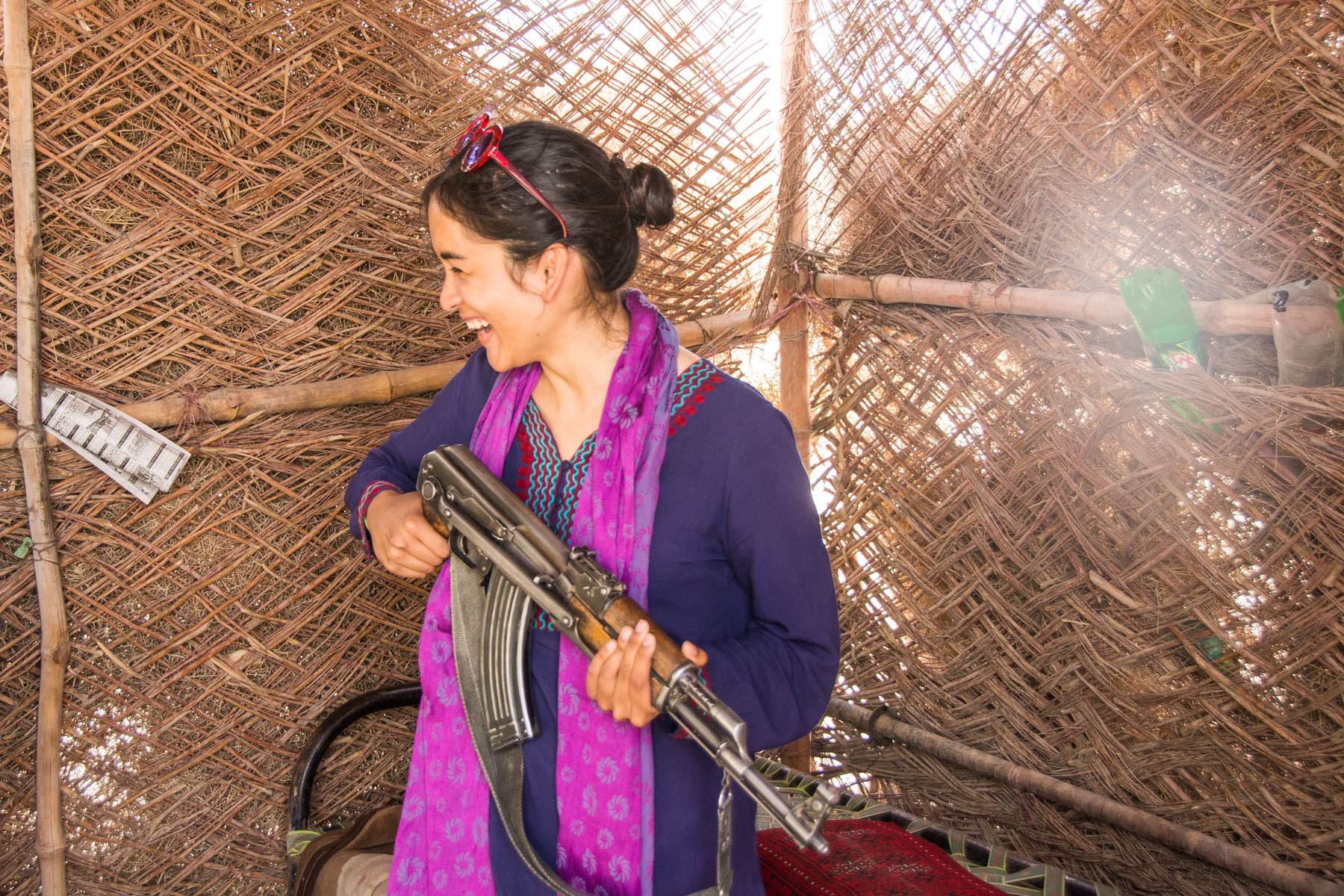 Girl holding a Kalashnikov on the border crossing from Iran to Pakistan