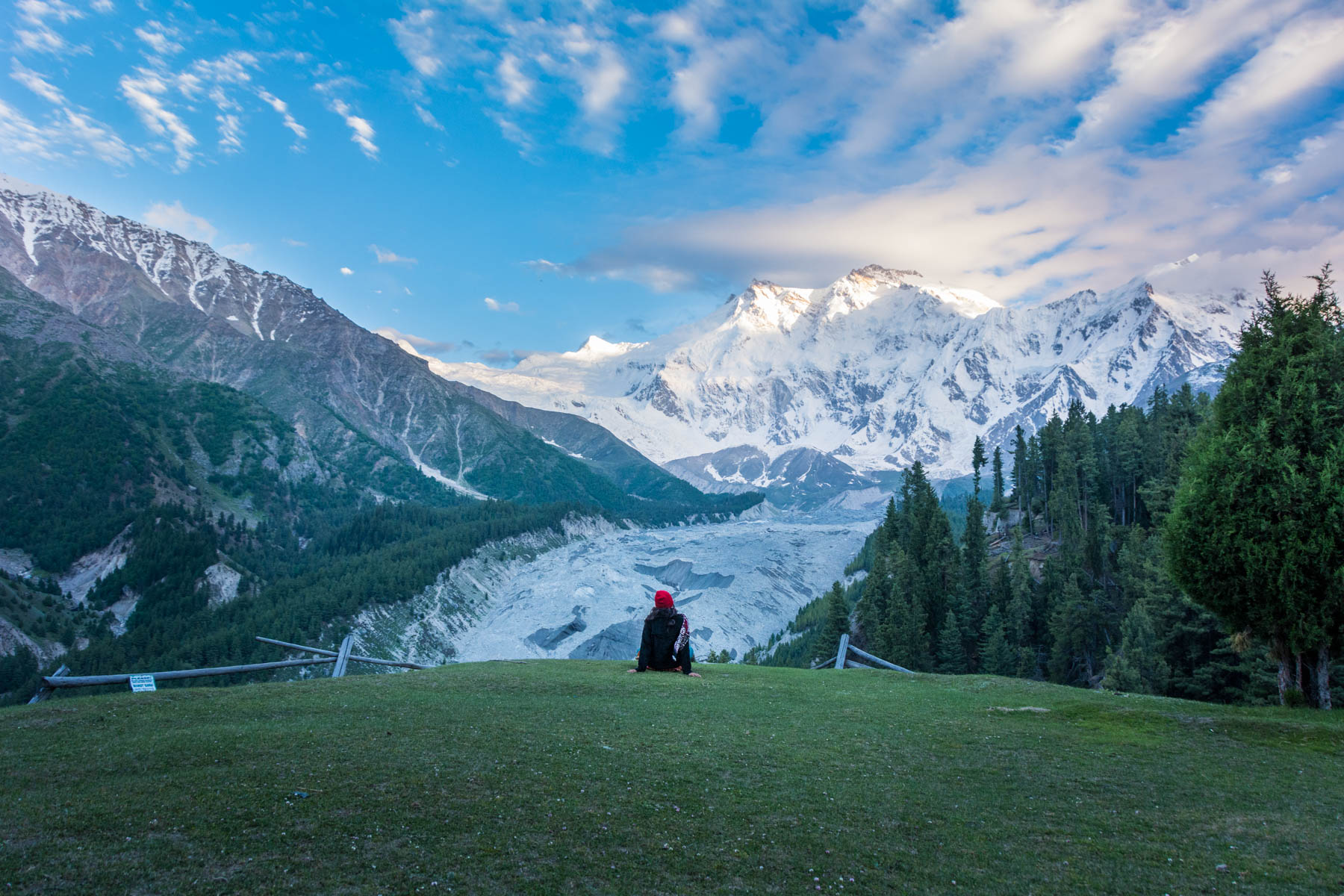 Solo female traveler checking out the sunset in Fairy Meadows, Pakistan
