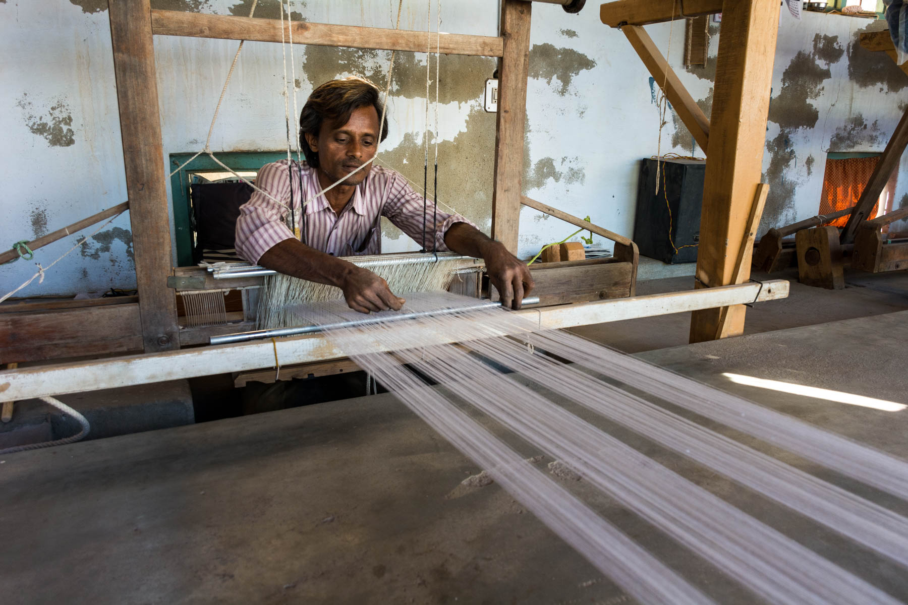 Textiles and crafts of Kutch, Gujarat, India - A local weaver at his loom in Bhujodi - Lost With Purpose