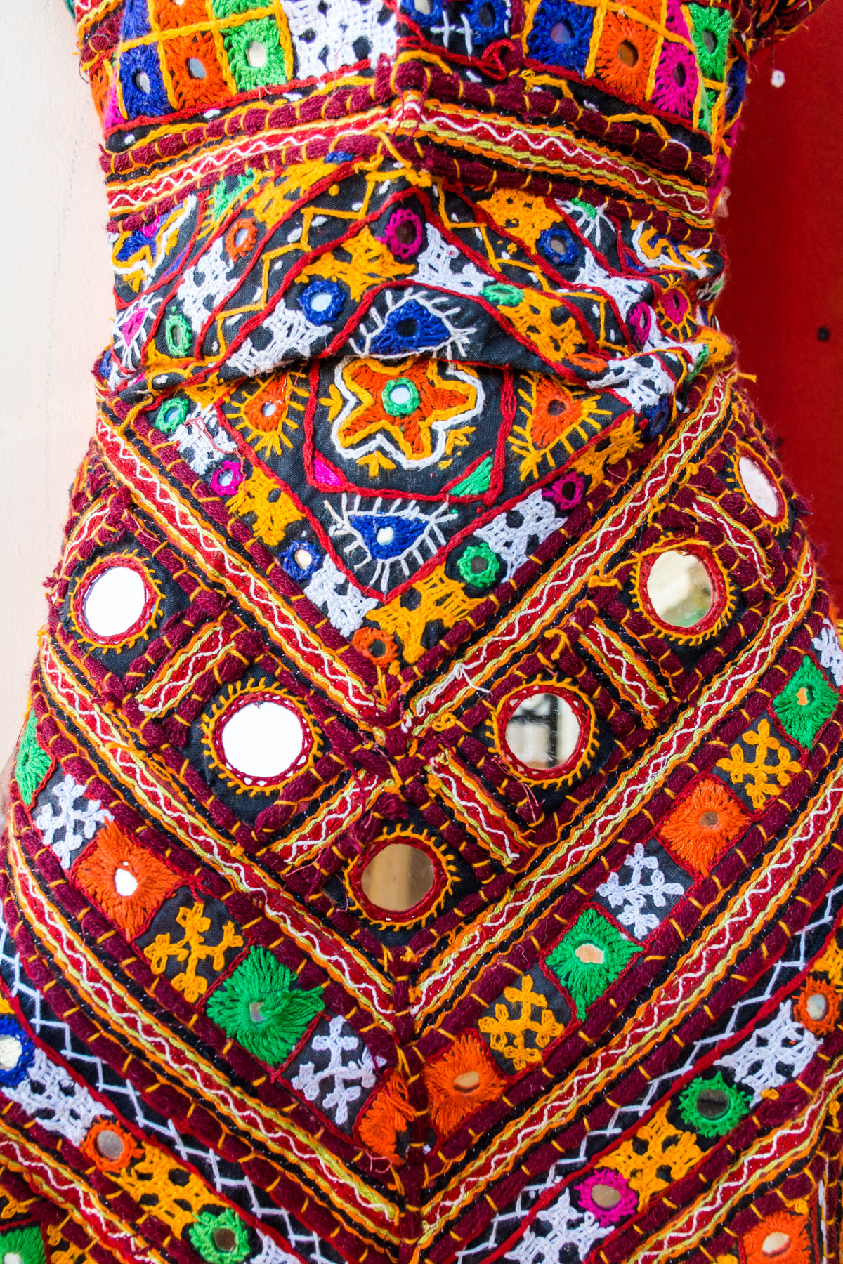 Traditional embroidered Kutch dress material with plenty of mirror work in Bhujodi, a small town in the Kutch region of Gujarat, India.