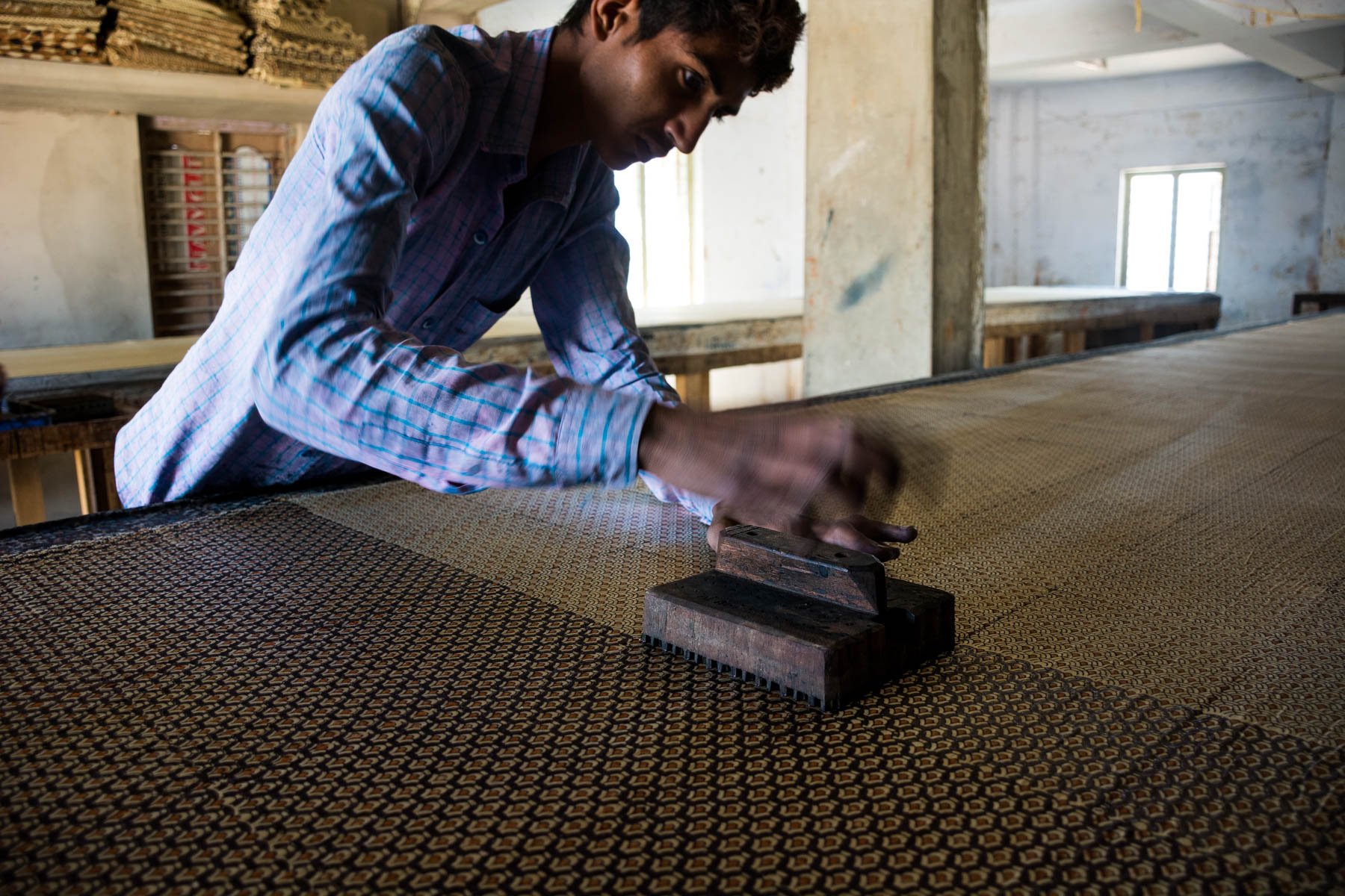 Textiles and crafts of Kutch, Gujarat, India - A man block printing by hand in Ajrakhpur, India - Lost With Purpose