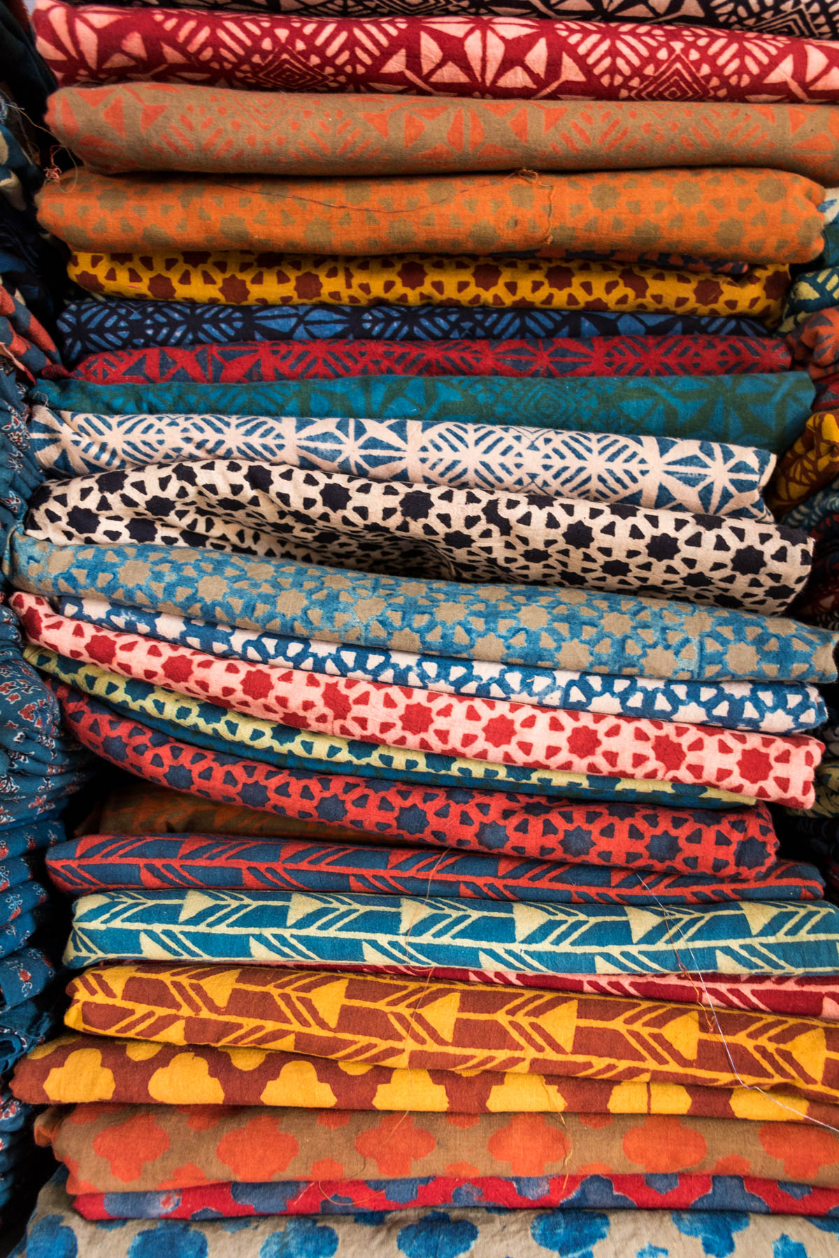 A colorful stack of Ajrakh fabric block printed by hand in Ajrakhpur. Ajrakhpur is a small Kutch village famous for its textiles near Bhuj in Gujarat state, India.