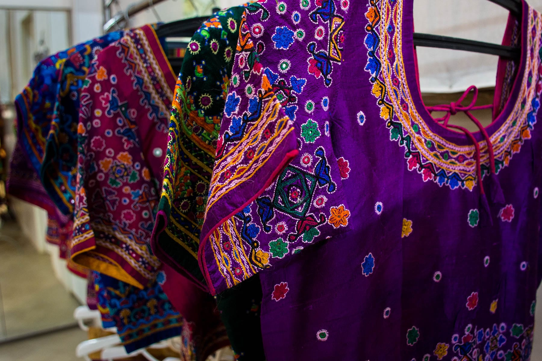 Textiles and crafts of Kutch, Gujarat, India - Colorful embroidered cholis in Bhujodi - Lost With Purpose