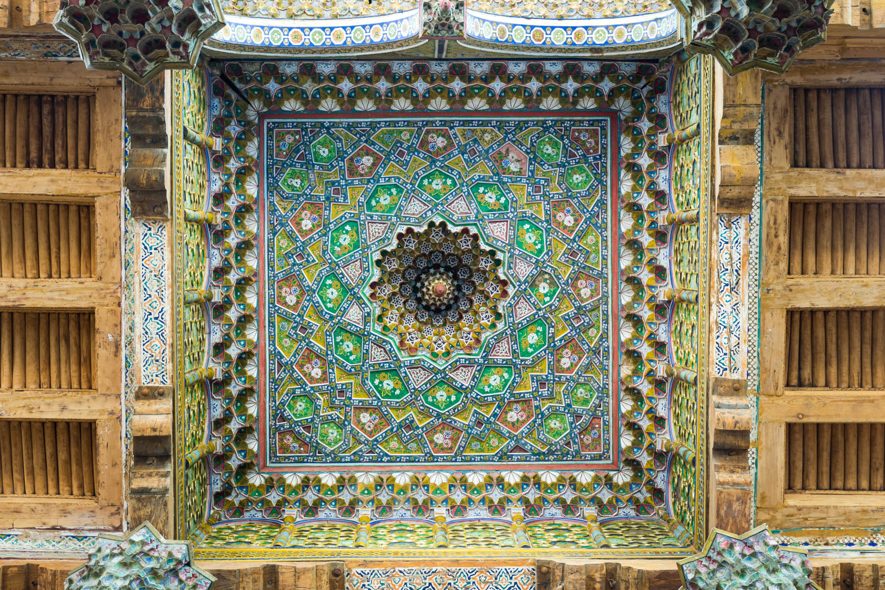Two week Uzbekistan itinerary - Wooden fractal ceiling of the Bolo Hauz mosque in Bukhara, Uzbekistan - Lost With Purpose