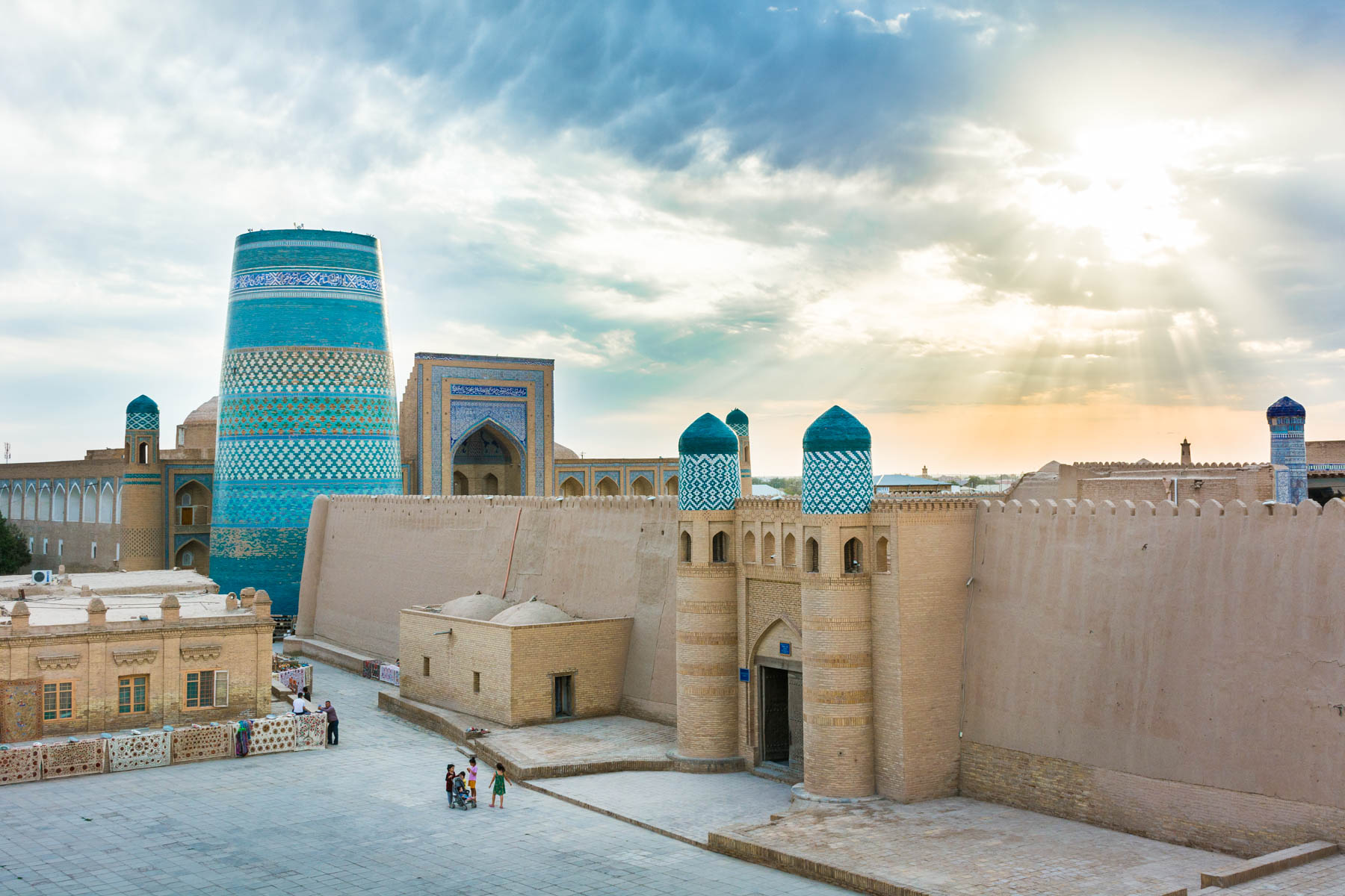 The sun breaking through the clouds over Khiva