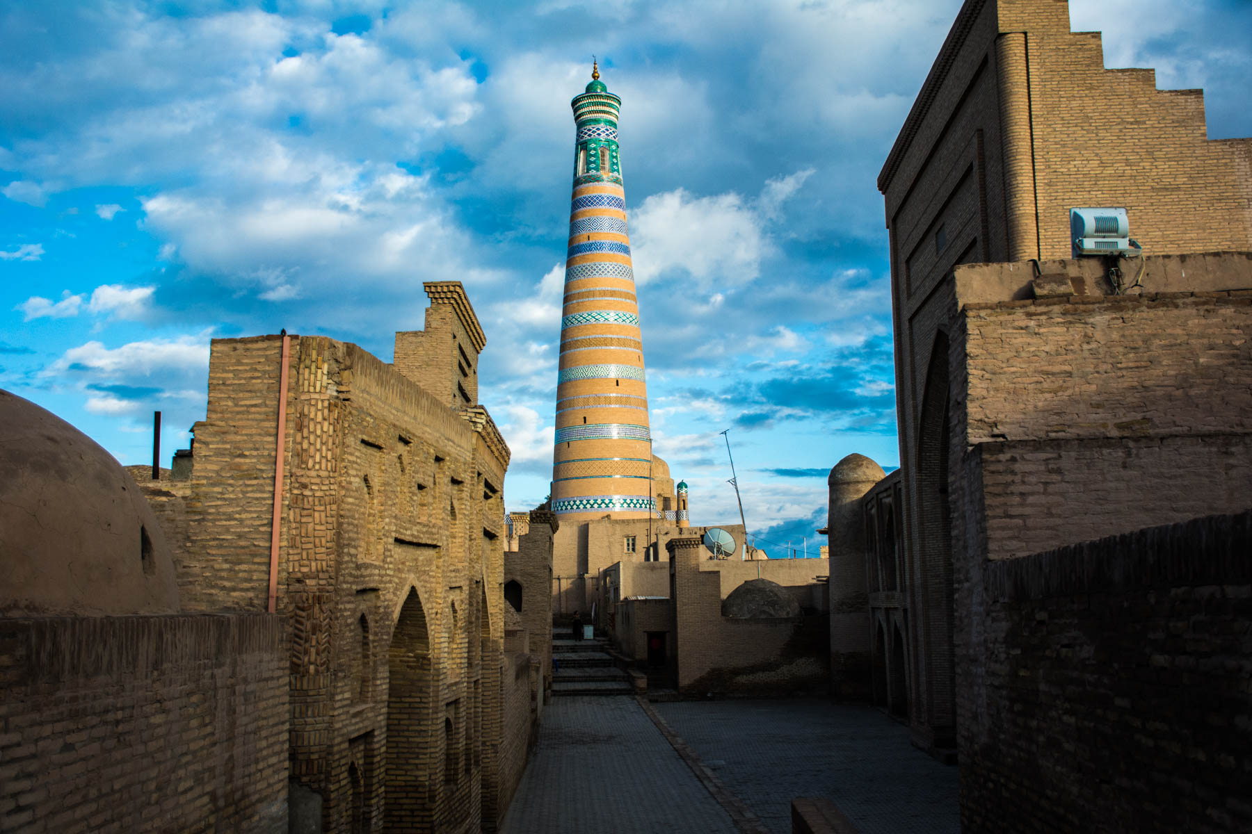 Two week Uzbekistan itinerary - Tura Murad Minaret in Khiva, Uzbekistan after a rain storm - Lost With Purpose