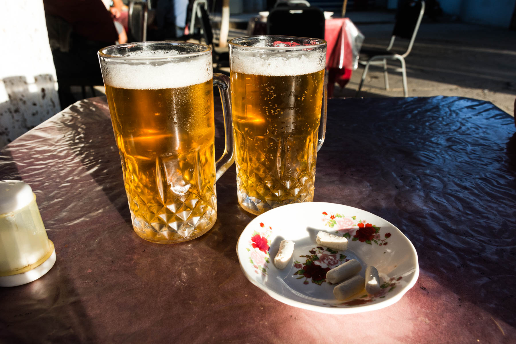 Two glasses of beer at a cafe in Termez