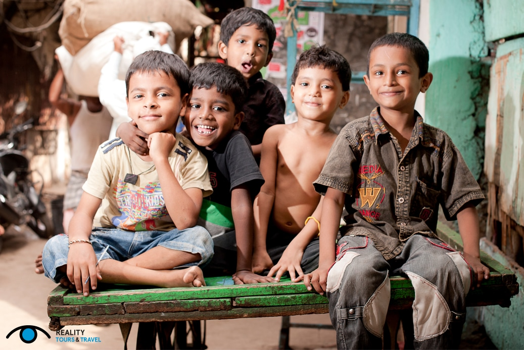 Is it weird to go on a slum tour in Mumbai, India? - Children in Dharavi slum - Image by Reality Tours