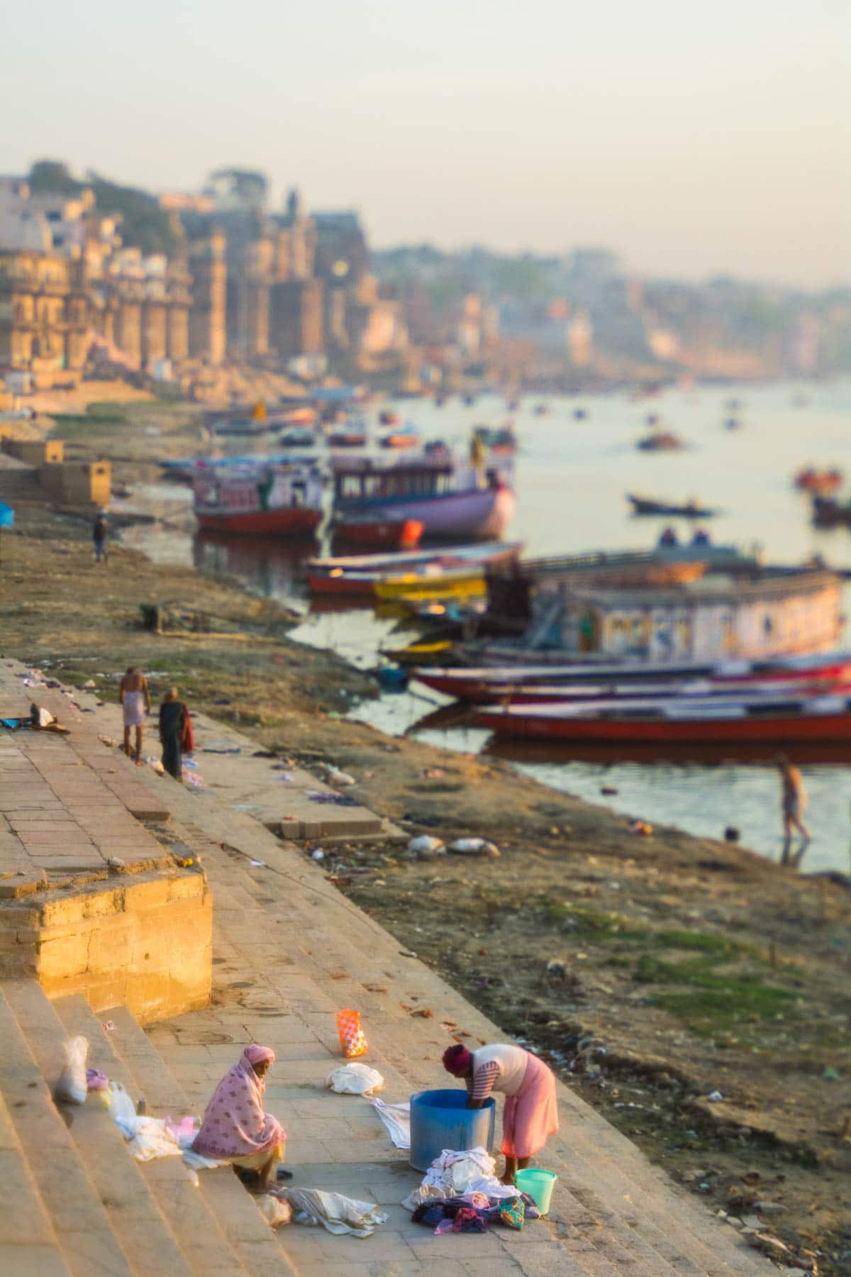 Men doing laundry by the Ganges river in Varanasi, India at sunrise. Shot with a Lensbaby Edge 50 Optic.