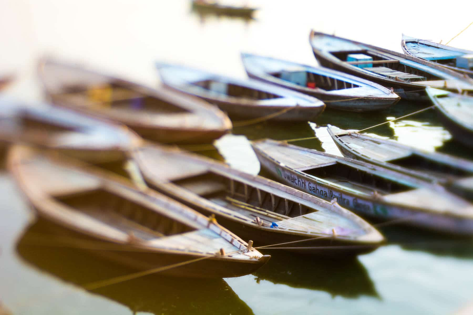 Lensbaby Edge 50 Optic review - Boats on the Ganges at sunrise in Varanasi, India - Lost With Purpose
