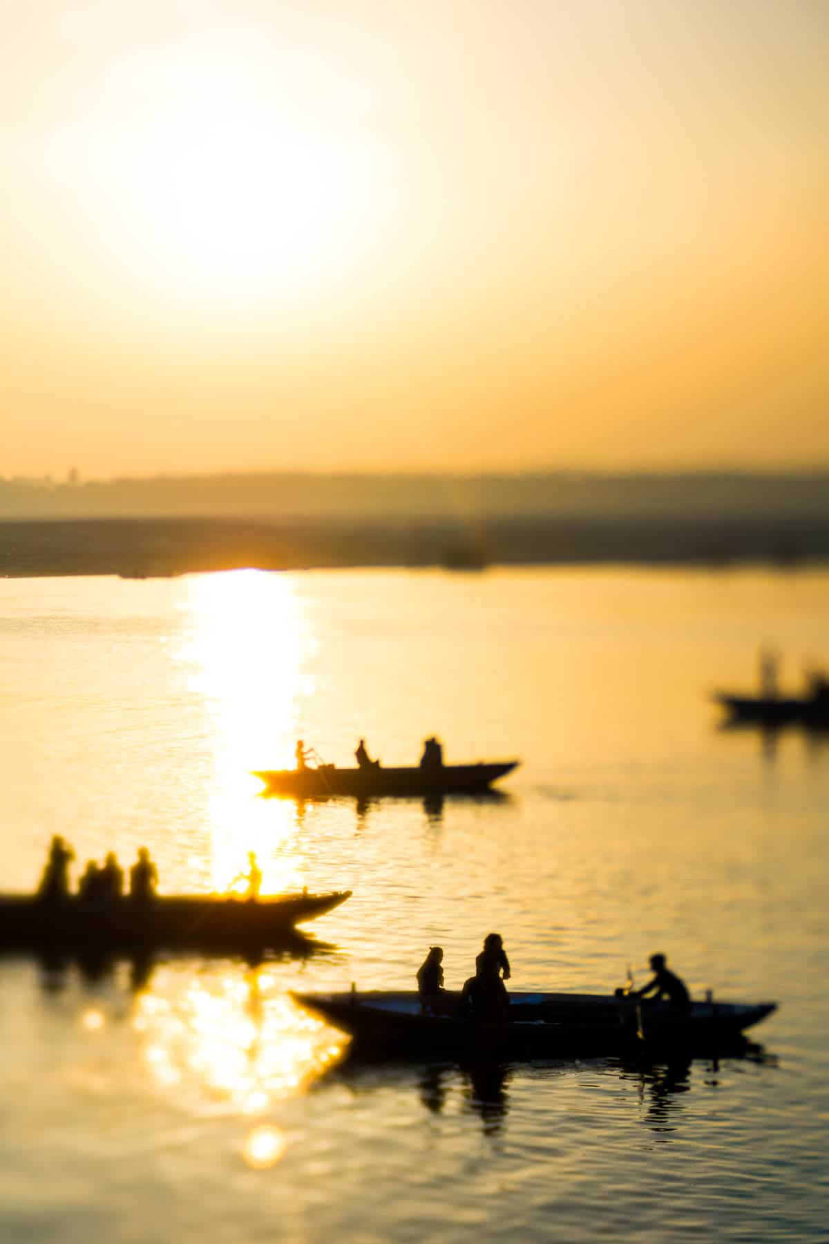 Sunrise boat rides on the Ganges in Varanasi, India, shot with a Lensbaby Edge 50 Optic.