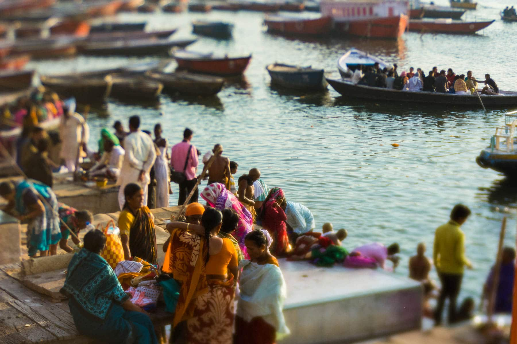 Lensbaby Edge 50 Optic review - Men and women waiting to take a boat ride on the Ganges in Varanasi, India - Lost With Purpose