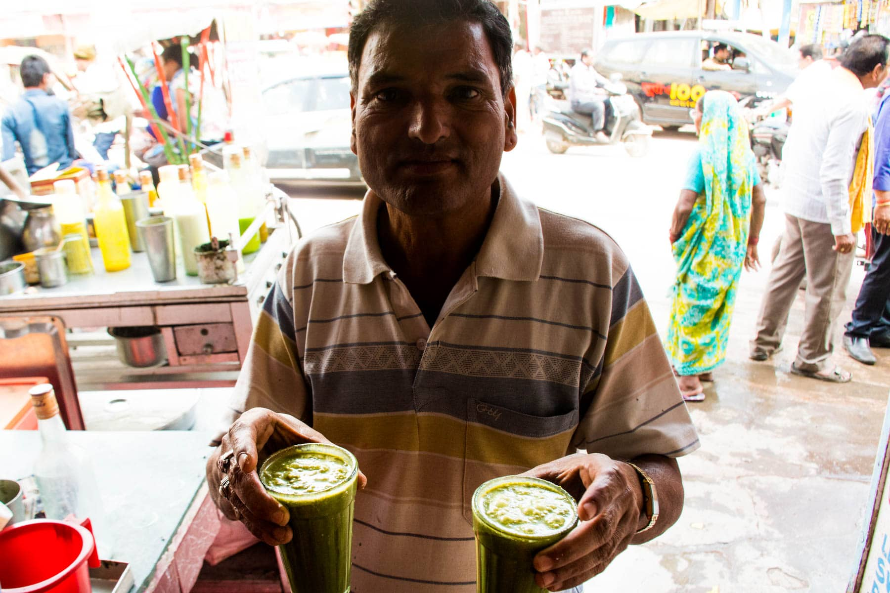 Where to find bhang lassi in Varanasi, India - Vendor selling glasses of bhang thandai in Badal Thandai in Varanasi - Lost With Purpose