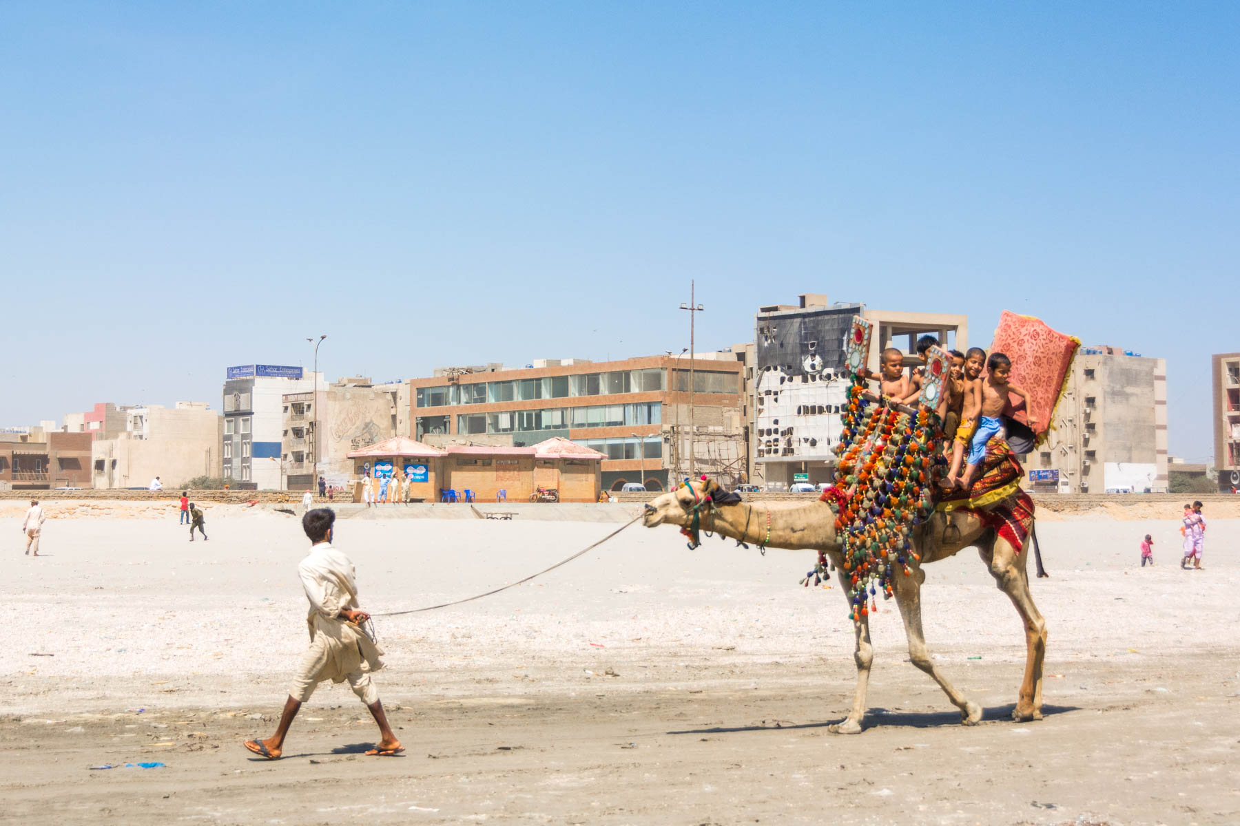 How much does a year of travel in Asia cost? - A camel ride on the beaches of Karachi, Pakistan - Lost With Purpose