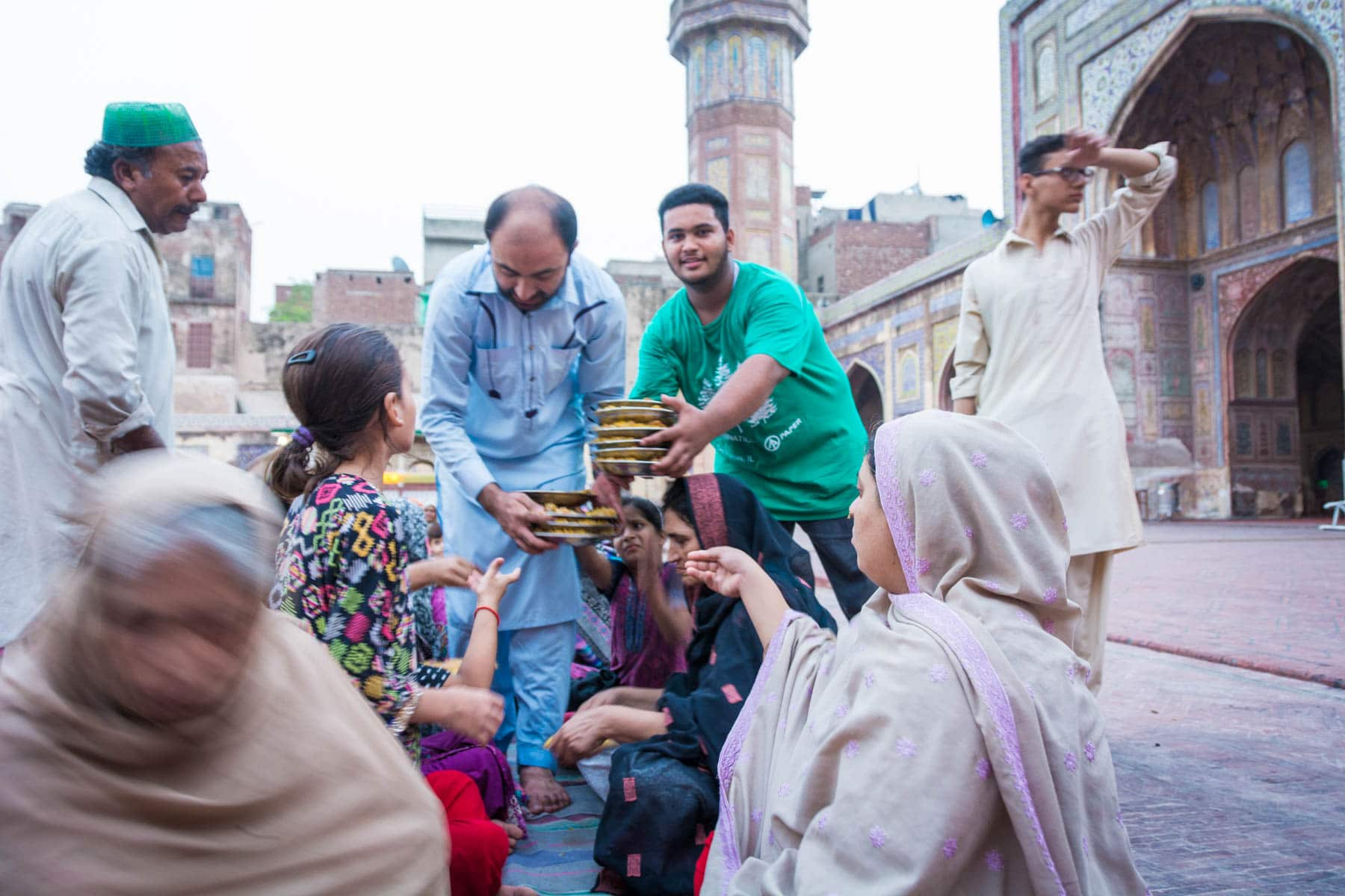 Should I travel in Pakistan during Ramadan - Friendly faces at iftar in Wazir Khan mosque in Lahore, Pakistan - Lost With Purpose