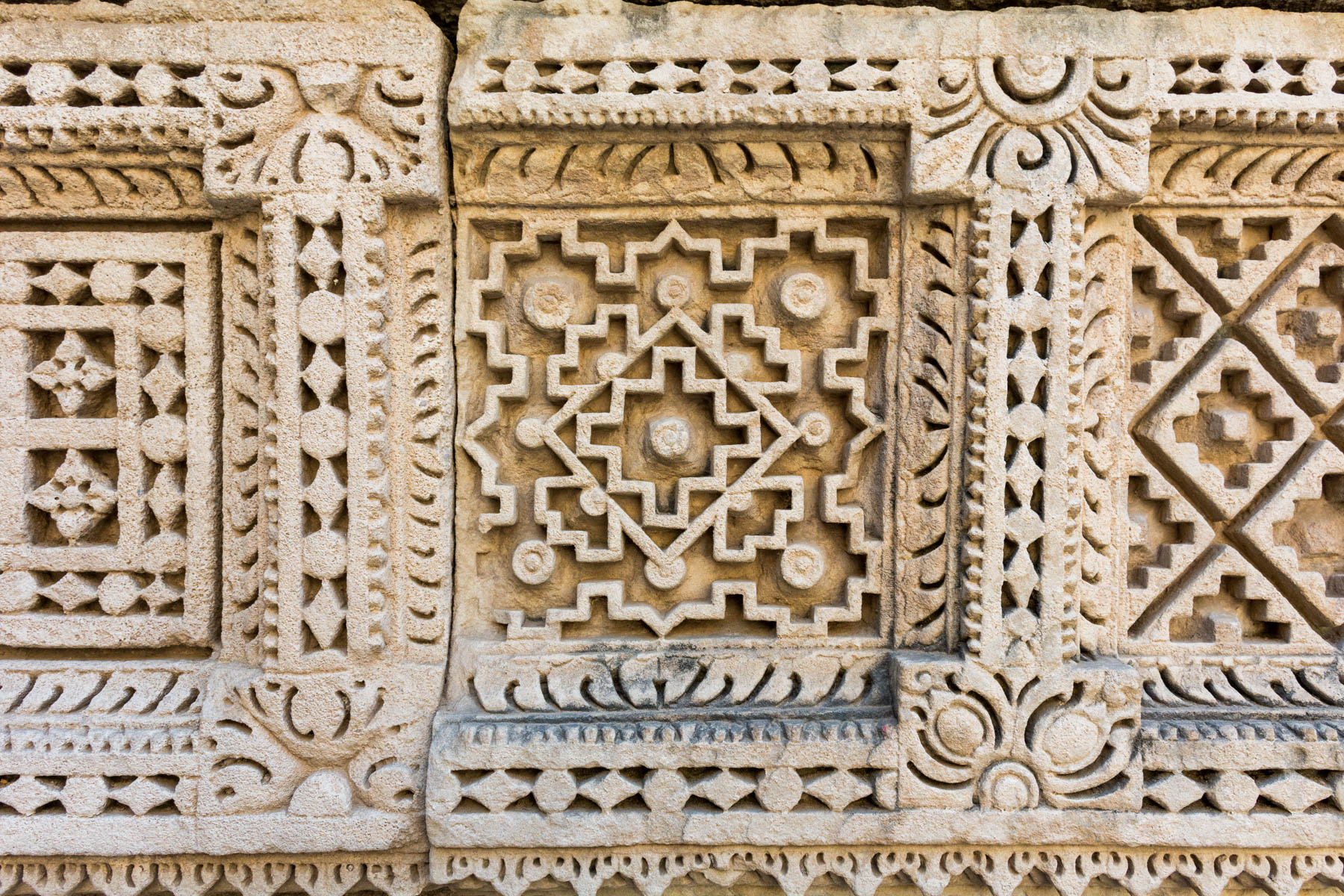 History of Patola in Patan, Gujarat, India - An ancient plate with a Patola design in Rani Ki Vav step well - Lost With Purpose