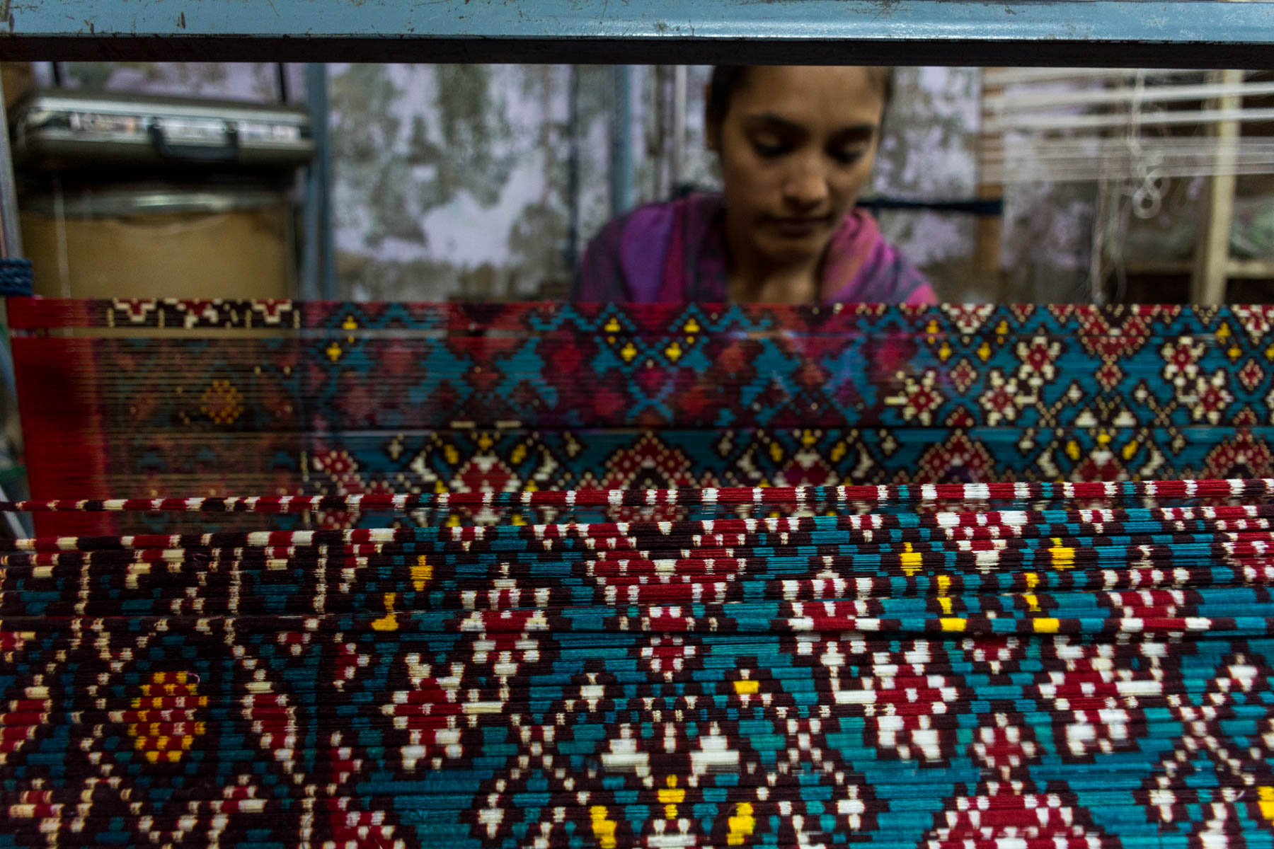 History of Patan Patola in Gujarat, India - A girl unwrapping Patola threads - Lost With Purpose
