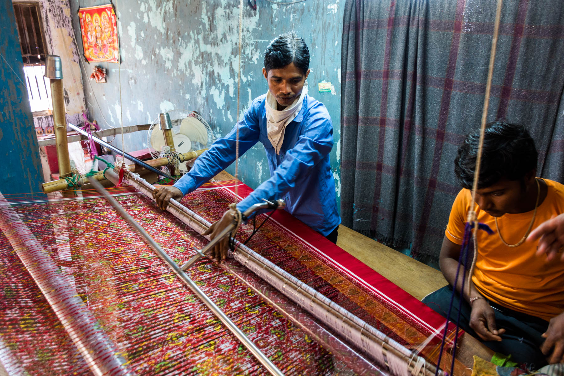 History of Patan Patola - A man in the workshop weaving a Patola on a loom - Lost With Purpose